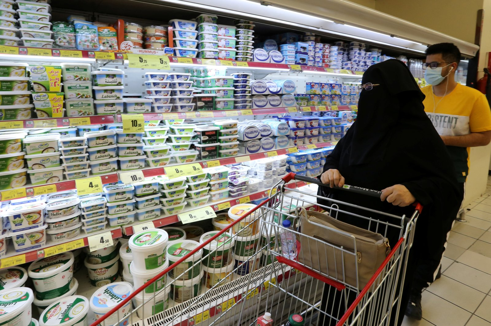 A Saudi woman looks at the dairy products in a supermarket in Riyadh, Saudi Arabia, Oct. 18, 2020. (Reuters Photo)