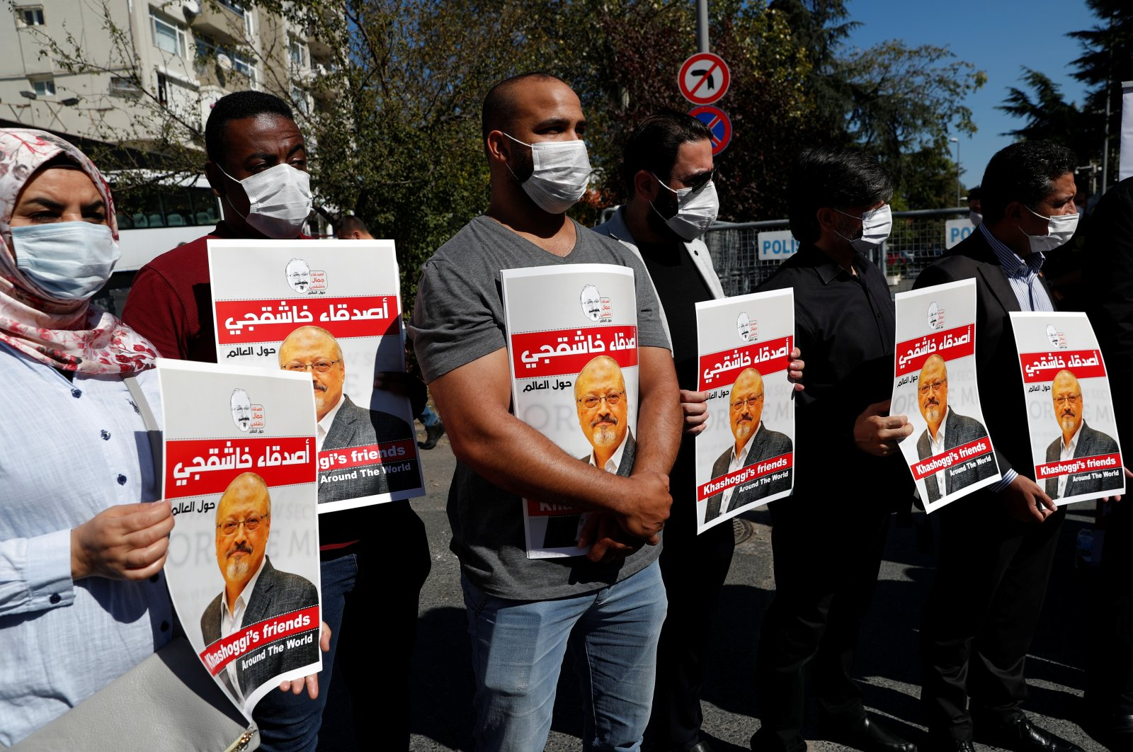 People hold pictures of Saudi journalist Jamal Khashoggi during a gathering to mark the second anniversary of Khashoggi's killing at the Saudi Consulate, in Istanbul, Turkey, October 2, 2020. (Reuters Photo)