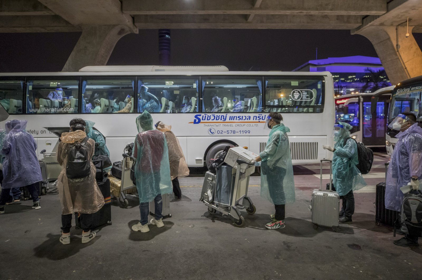 Chinese tourists from Shanghai who arrived on special tourist visas, board a bus at Suvarnabhumi airport in Bangkok, Thailand, Oct. 20, 2020. (AP Photo)
