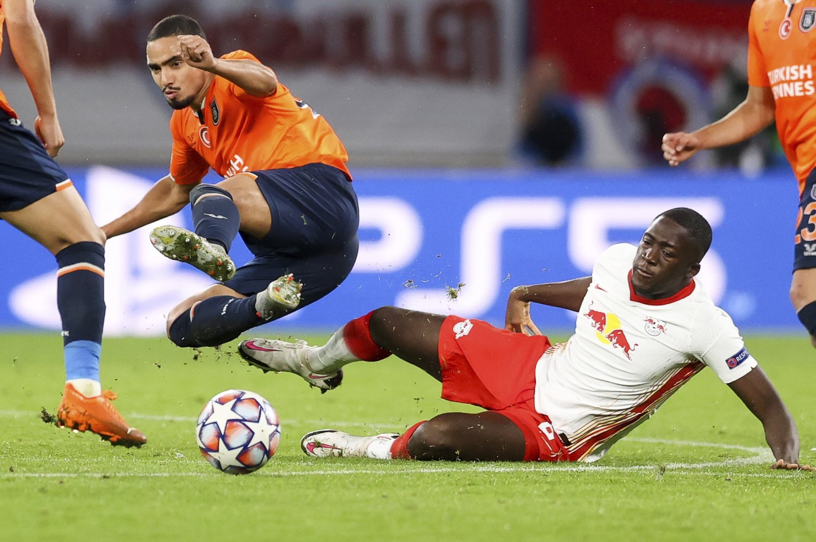Leipzig's Ibrahima Konate, right, and Istanbul Başakşehir's Rafael compete for the ball during a Group H Champions League soccer match at the RB Arena in Leipzig, Germany, Tuesday Oct. 20, 2020. (Jan Woitas/dpa via AP)