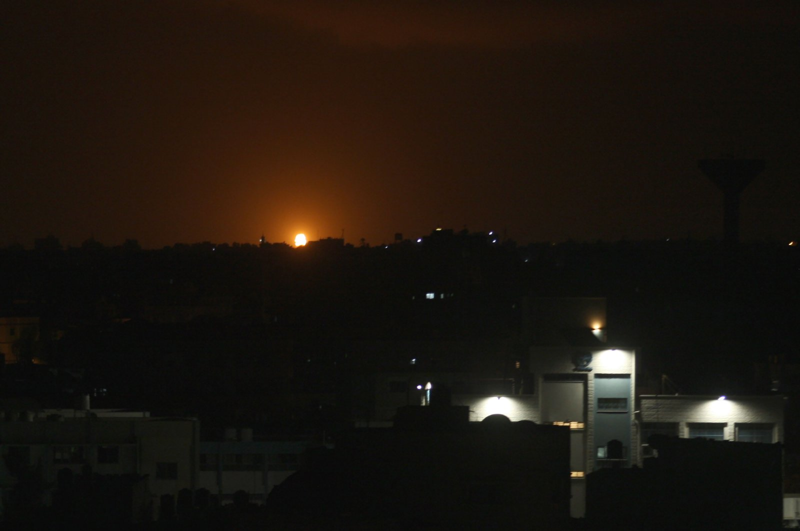 Flames can be seen following an Israeli airstrike in the town of Deir al-Balah in the central Gaza Strip, Oct. 20, 2020. (AFP Photo)
