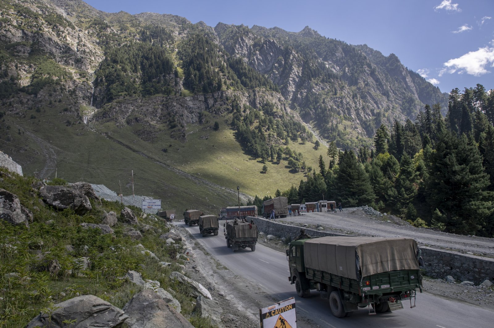 An Indian army convoy moves on the Srinagar-Ladakh highway at Gagangeer, northeast of Srinagar, Indian-controlled Kashmir on Sept. 9, 2020. (AP Photo)
