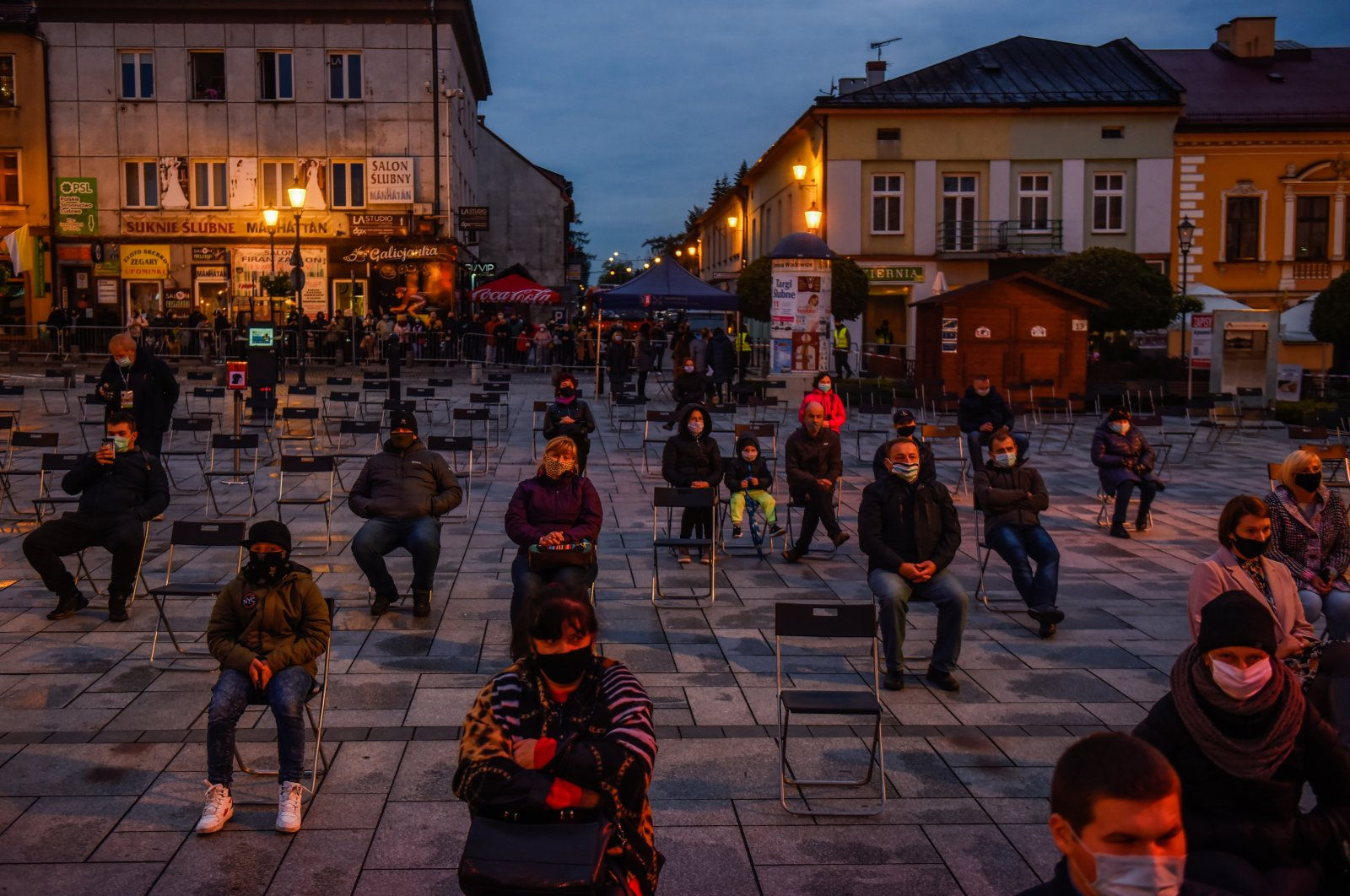 Fans wear protective masks and sit under social distance measures during a concert at the Main Square, in Wadowice, Poland, Oct. 18, 2020. (Photo by Getty Images)