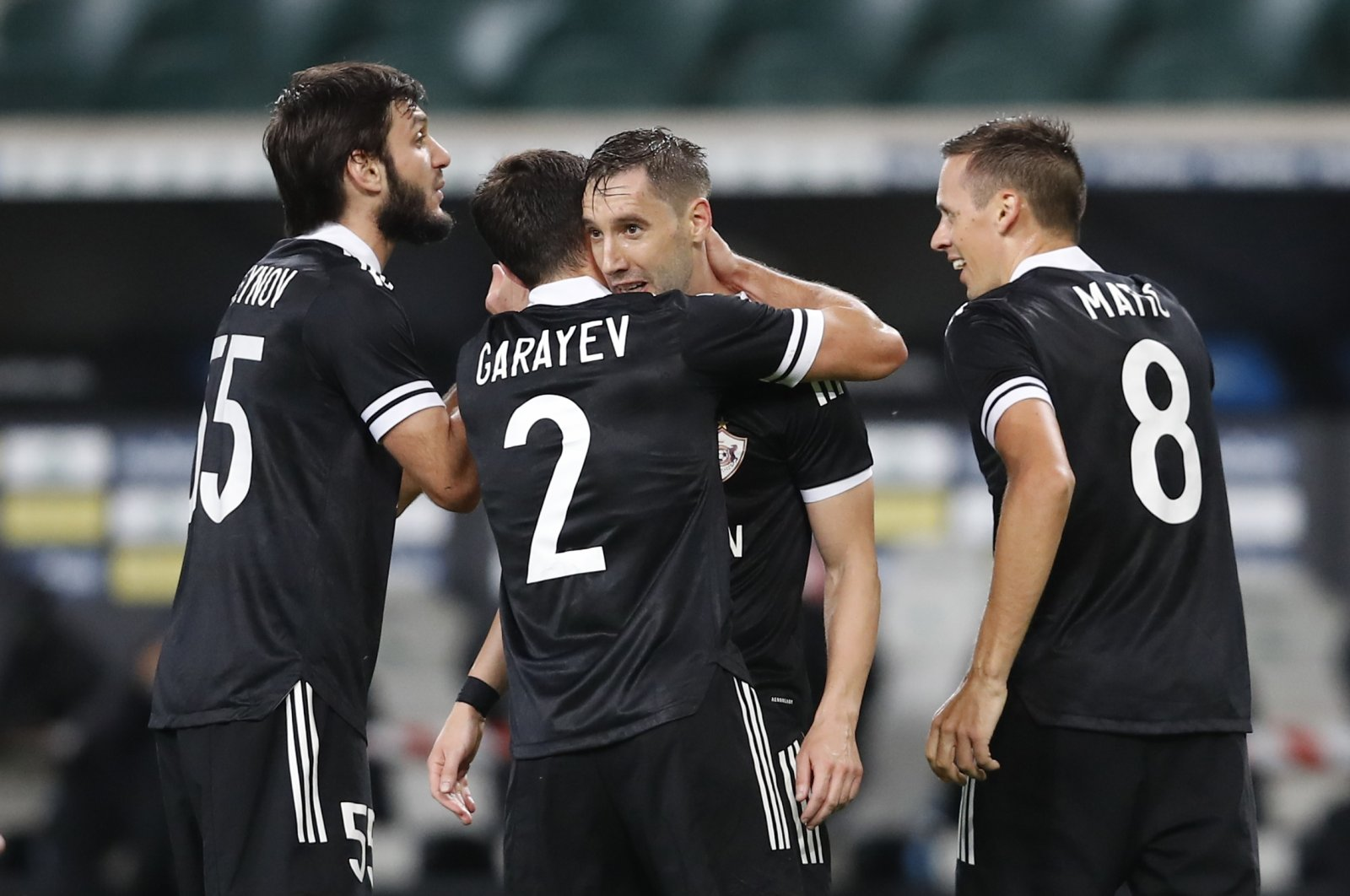 Qarabag players celebrate after defeating Legia Warsaw in UEFA Europa League qualifiers, in Warsaw, Poland, Oct. 1, 2020. (Reuters Photo)