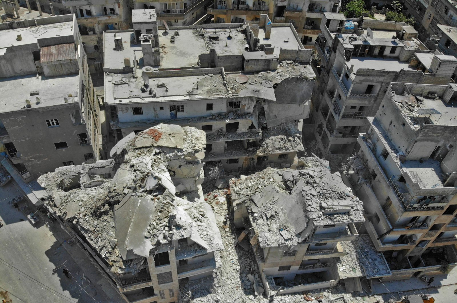 This picture taken with a drone shows the site of a reported airstrike on the town of Ariha, in the south of Syria's Idlib province, July 27, 2019. (AFP File Photo)
