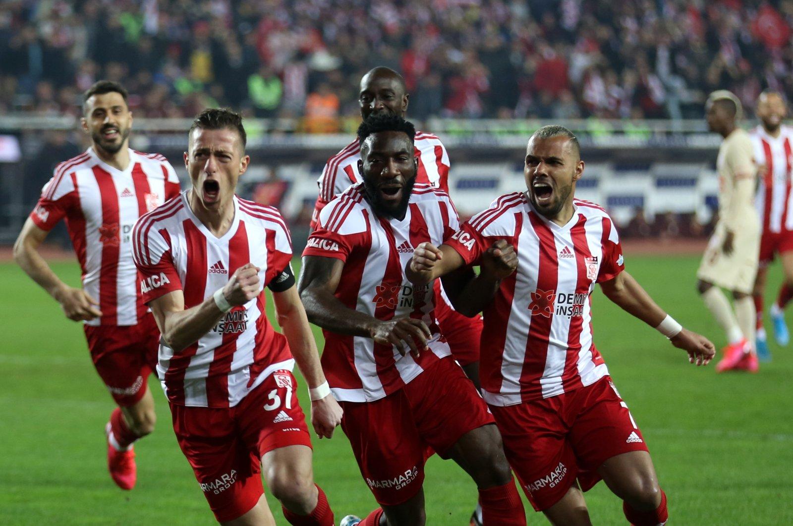 Sivasspor players celebrate a goal during a Süper Lig match in Sivas, Turkey, March 8, 2020. (AA Photo)