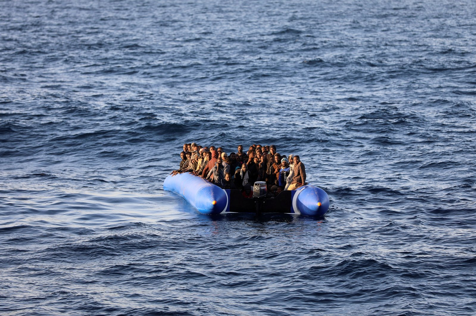 Migrants in a dinghy are rescued by Libyan coast guards off the coast of Garabulli, east of Tripoli, Libya, Jan. 8, 2018. (Reuters Photo)