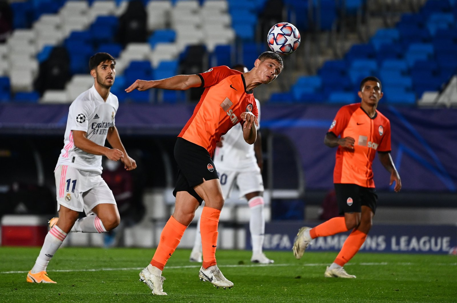 Shakhtar Donetsk's Ukrainian defender Valeriy Bondar (C) heads the ball during the UEFA Champions League group B football match between Real Madrid and Shakhtar Donetsk at the Alfredo di Stefano stadium in Valdebebas, Madrid, Spain, Oct. 21, 2020. (AFP Photo)