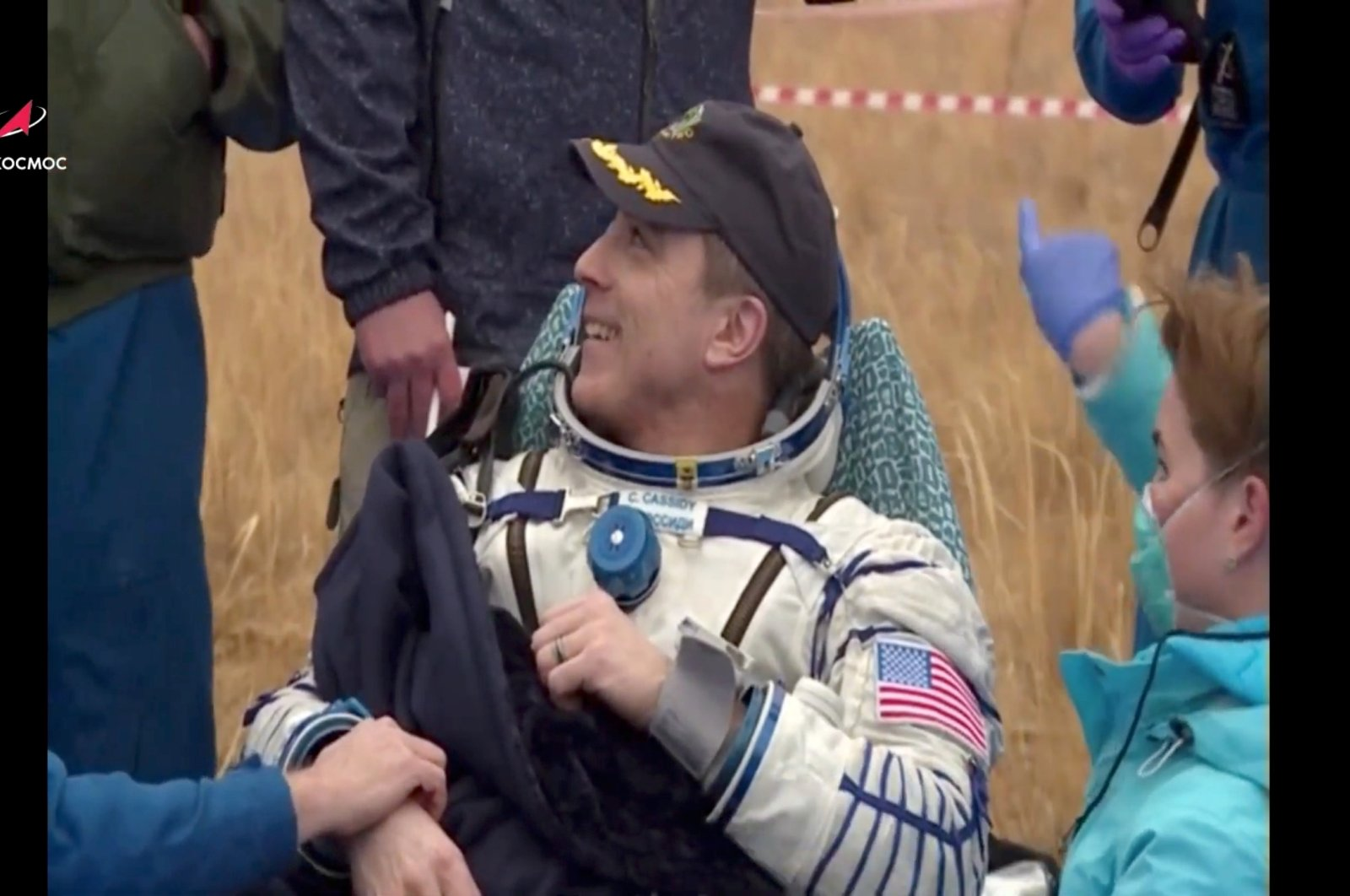 International Space Station (ISS) crew member Christopher Cassidy of NASA reacts after the landing of the Soyuz MS-16 capsule in a remote area outside Zhezkazgan, Kazakhstan October 22, 2020, in this still image taken from video. (Russian space agency Roscosmos via Reuters)
