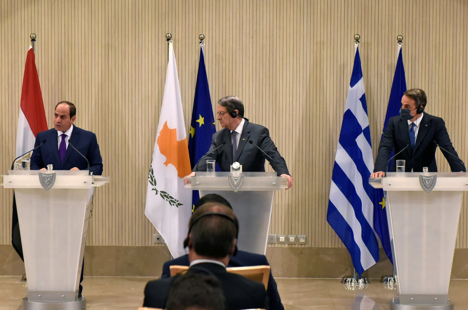 Greek Cypriot leader Nicos Anastasiades, Greek Prime Minister Kyriakos Mitsotakis and Egyptian President Abdel-Fattah el-Sissi are seen during a news conference after a trilateral summit in Nicosia, Greek Cyprus, Oct. 21, 2020. (Reuters Photo)