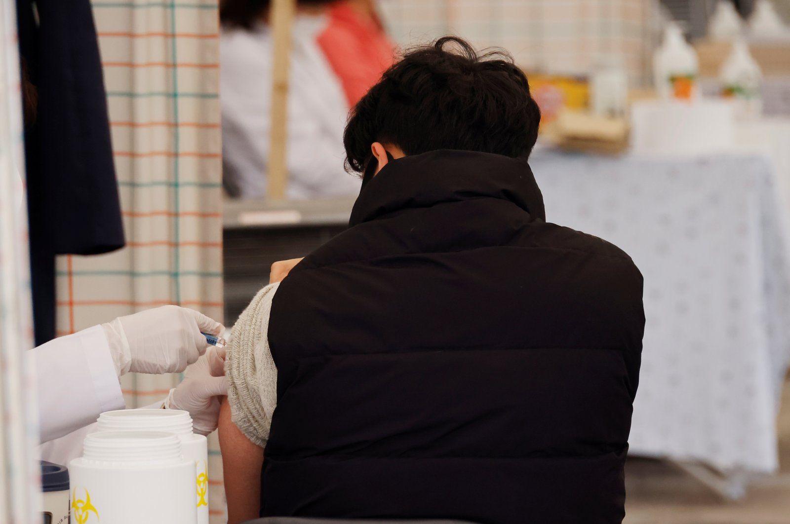 A man gets an influenza vaccine at a hospital in Seoul, South Korea, Oct. 21, 2020. (Reuters Photo)