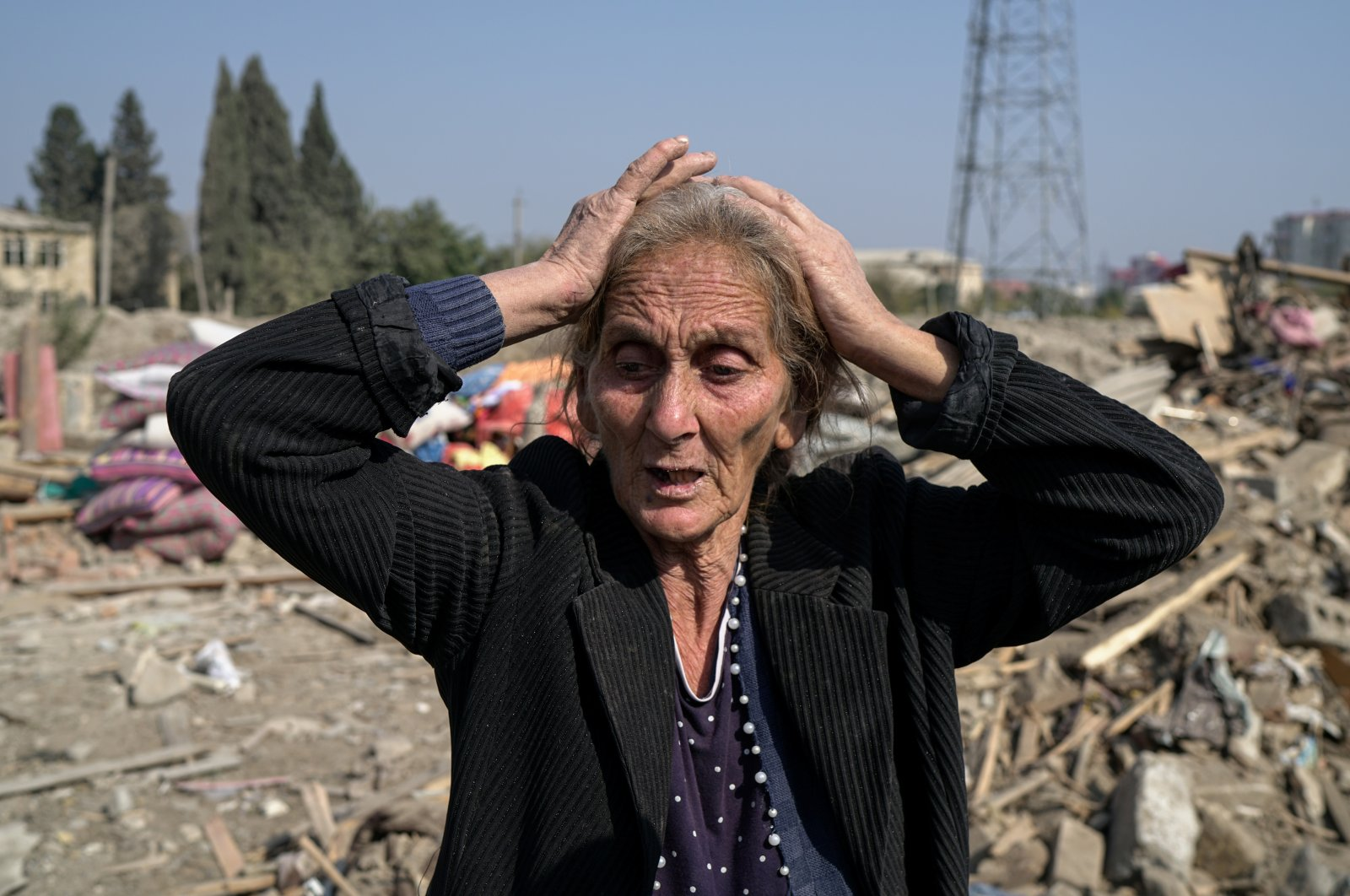 Regibe Guluyeva, 67, reacts as she stands on the ruins of her home, which was hit by an Armenian rocket, in the city of Ganja, Azerbaijan Oct. 18, 2020. REUTERS