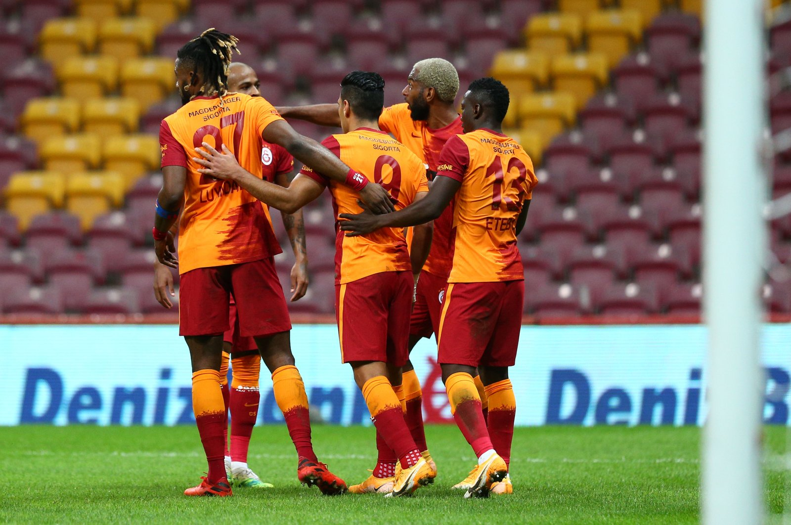 Galatasaray players celebrate in front of empty stands during a Süper Lig match against Alanyaspor, in Istanbul, Turkey, Oct. 19, 2020. (AA Photo)