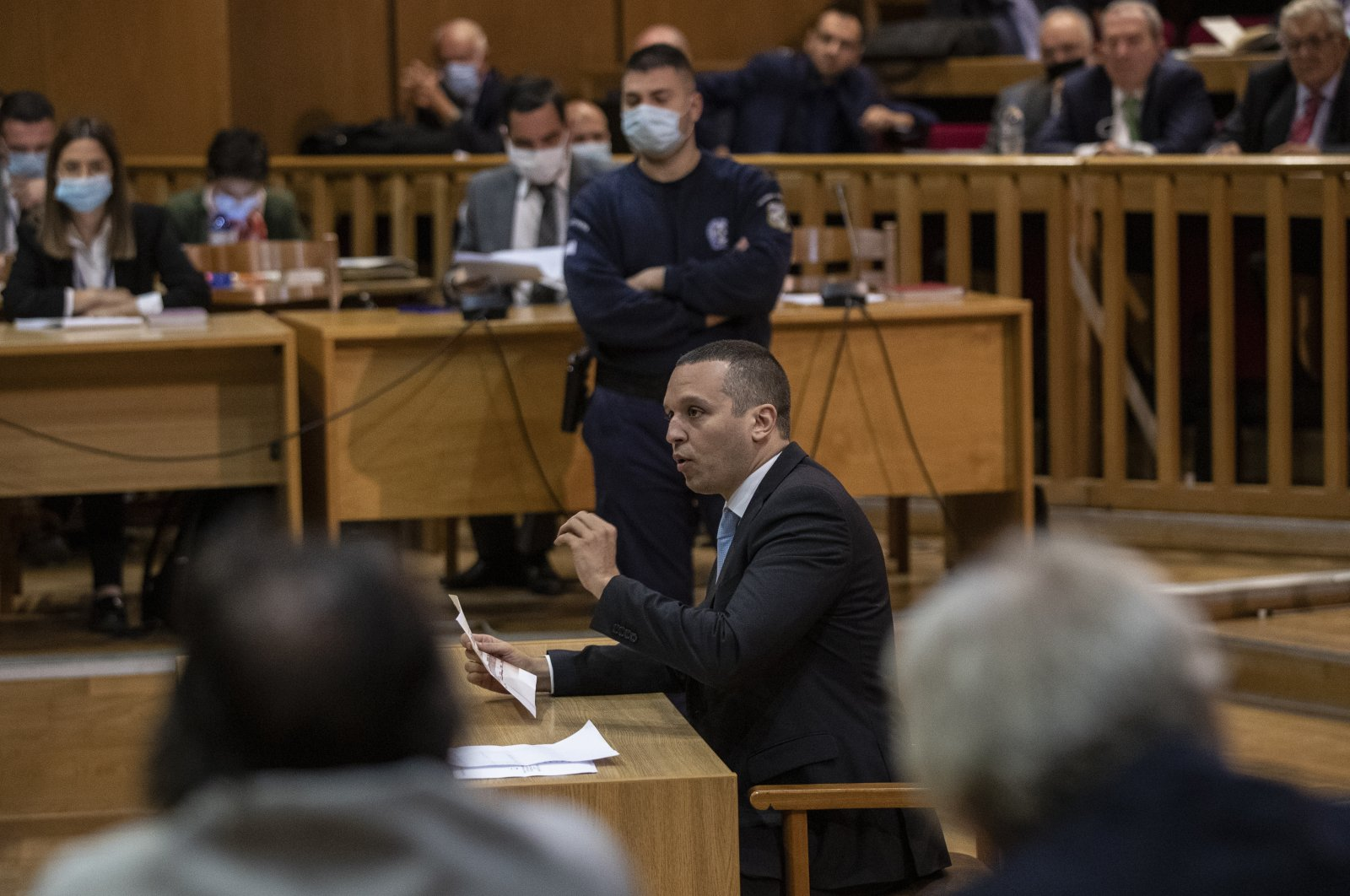 Iias Kasidiaris, former Golden Dawn lawmaker who had been found guilty along with others of leading a criminal organization and face 13 years in prison, speaks during a Golden Dawn trial, in Athens, Oct. 21, 2020. (AP Photo)
