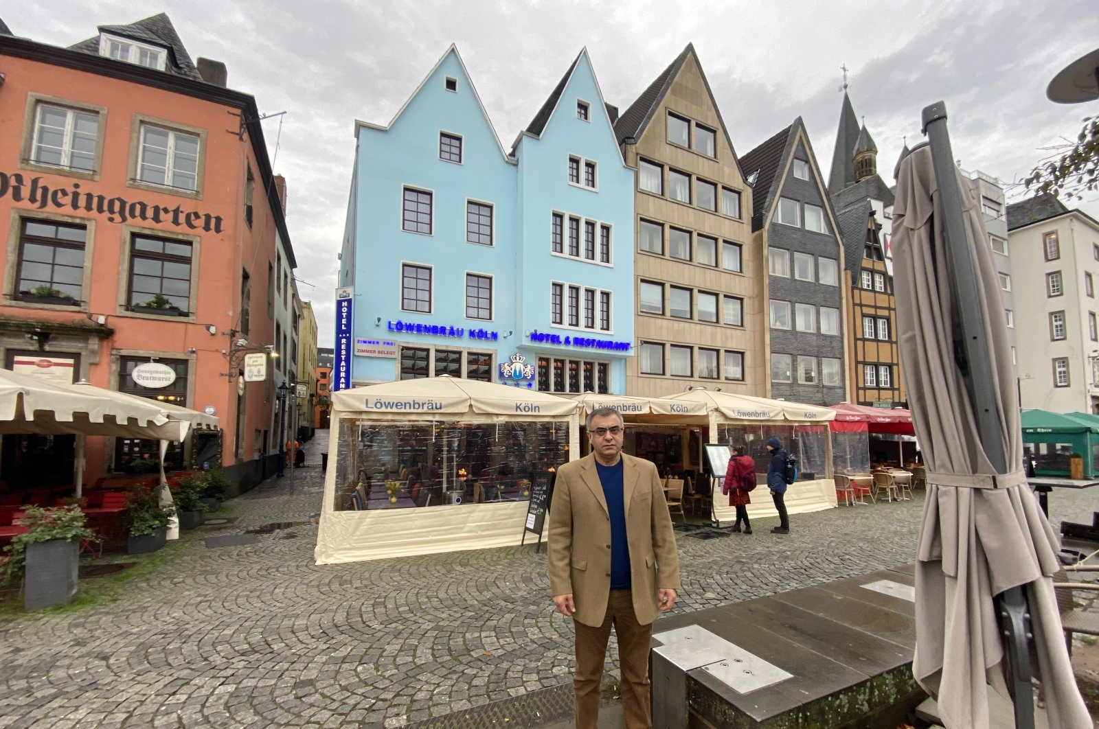Fazıl Bay, the owner of LöwenBrau Hotel and Restaurant in Cologne, poses in front of his restaurant, Cologne, Germany, Oct. 22, 2020. (AA Photo)