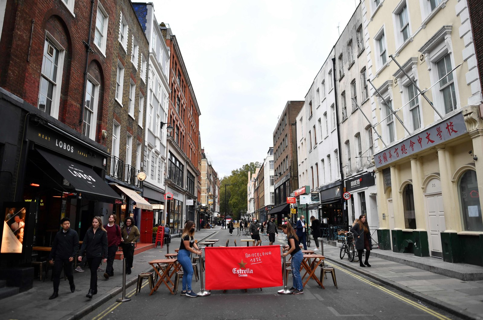 Employees place tables outside their restaurant in preparation for evening business, on Frith Street, Soho in the West End of London, the U.K., Oct. 16, 2020. (AFP Photo)