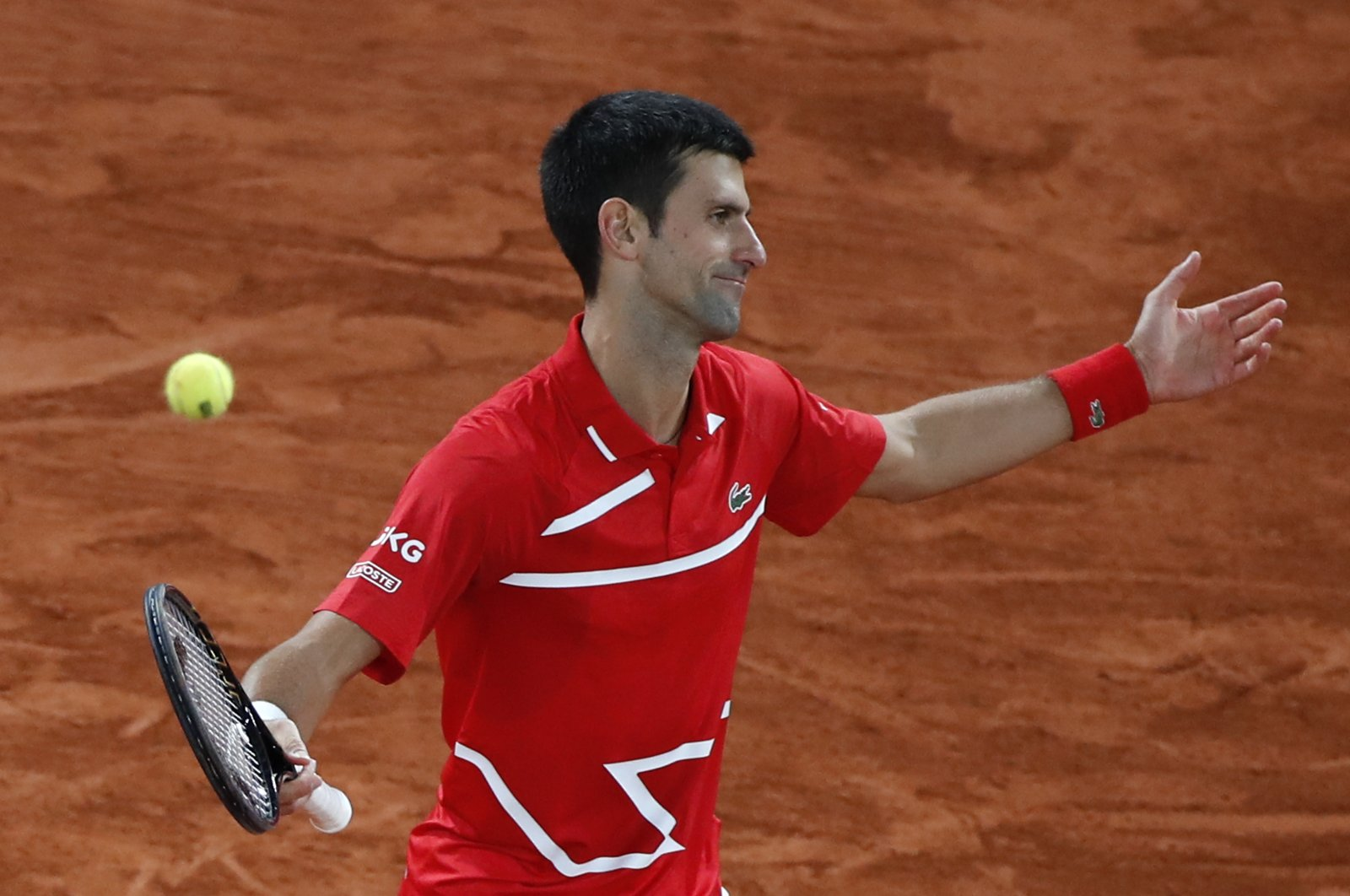 Novak Djokovic reacts during the French Open final match against Rafael Nadal, in Paris, France, Oct. 11, 2020. (AP Photo)