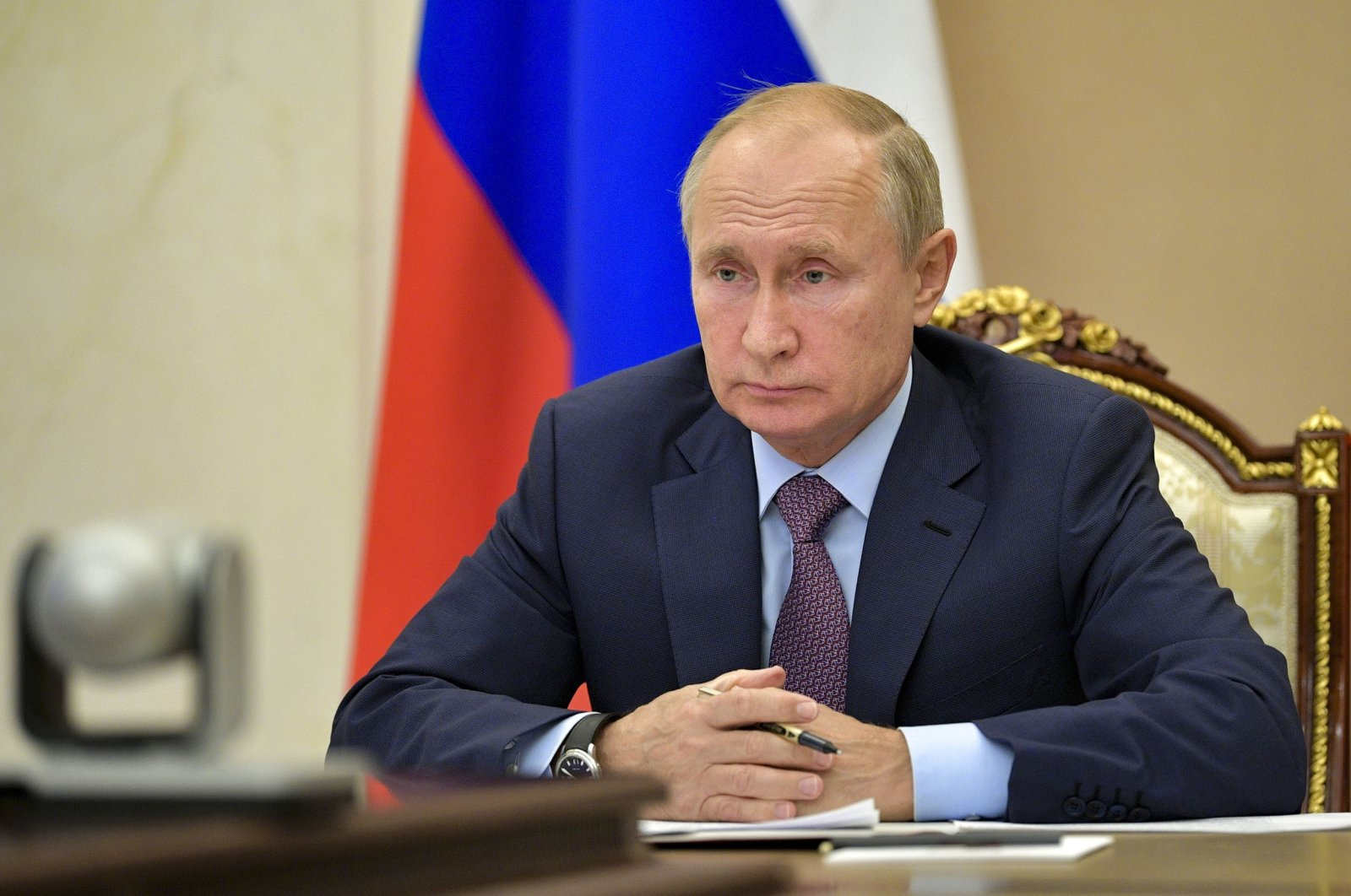 Russian President Vladimir Putin attends a videoconference at the Novo-Ogaryovo residence outside Moscow, Russia, Wednesday, Oct. 14, 2020. (Alexei Druzhinin, Sputnik, Kremlin Pool Photo via AP)