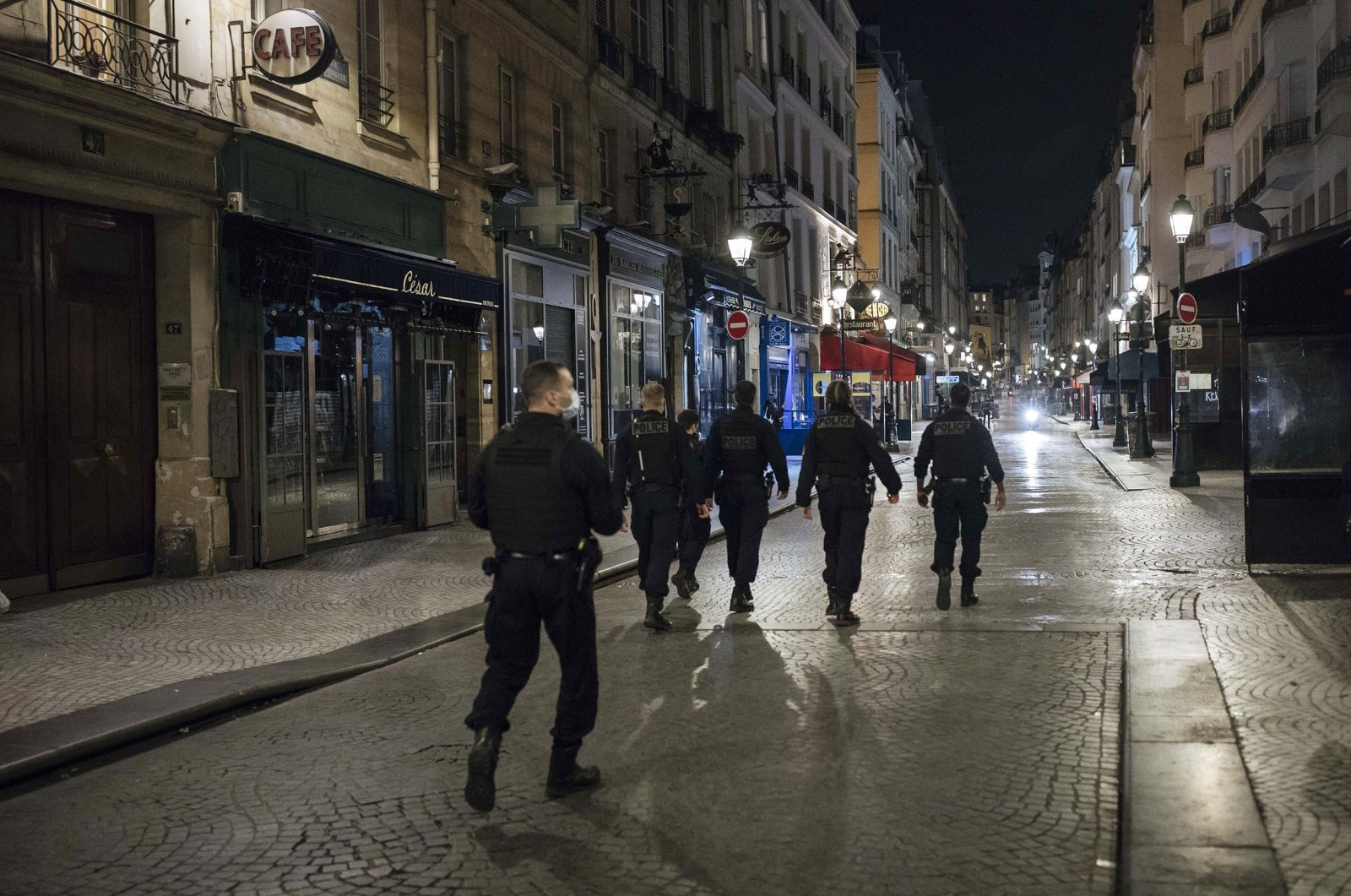 Police patrol in the streets as the curfew starts in Paris, Oct. 17, 2020. (AP Photo)