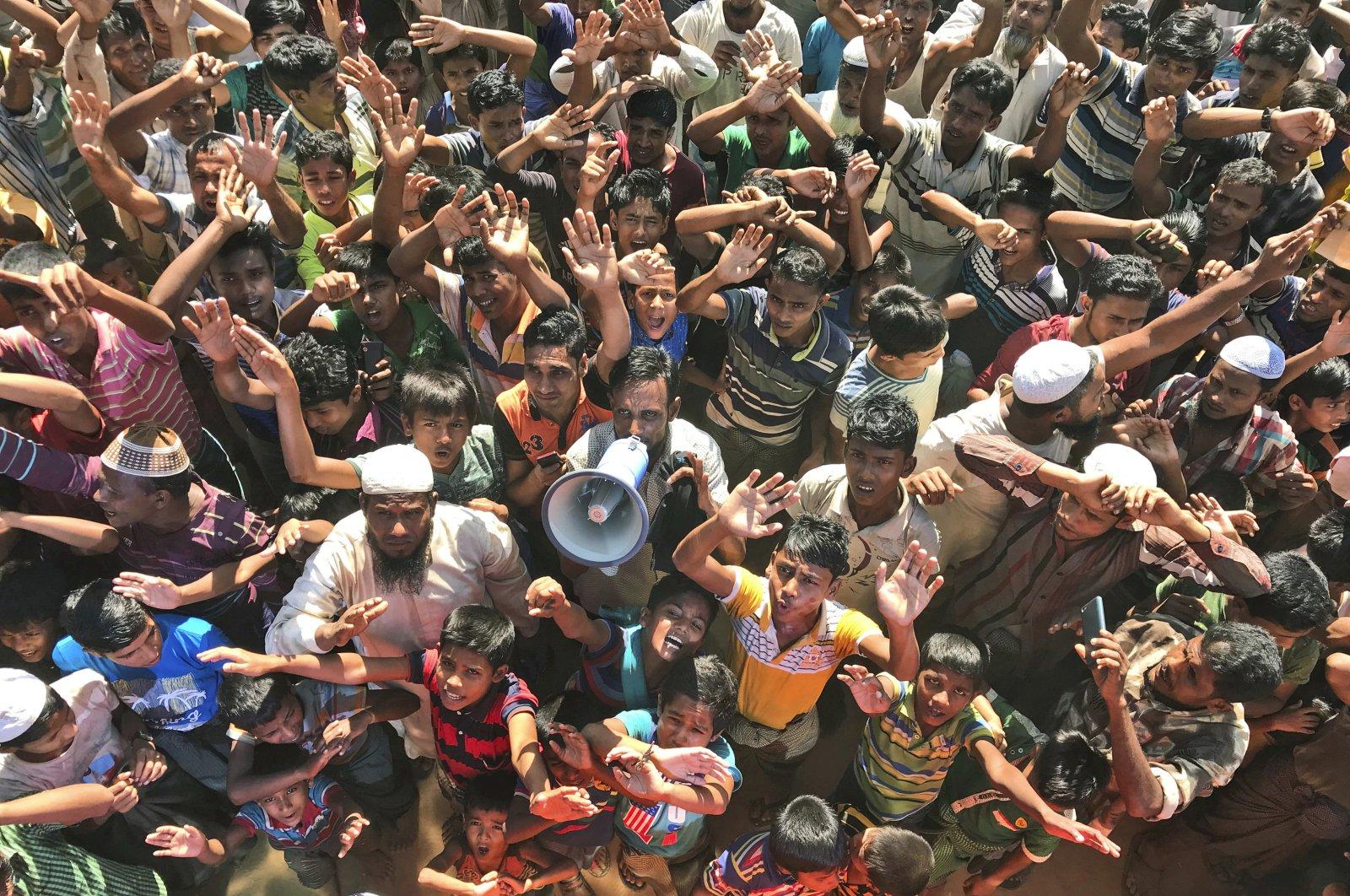 Rohingya refugees shout slogans against repatriation at Unchiprang camp near Cox's Bazar, Bangladesh, Nov. 15, 2018. (AP Photo)