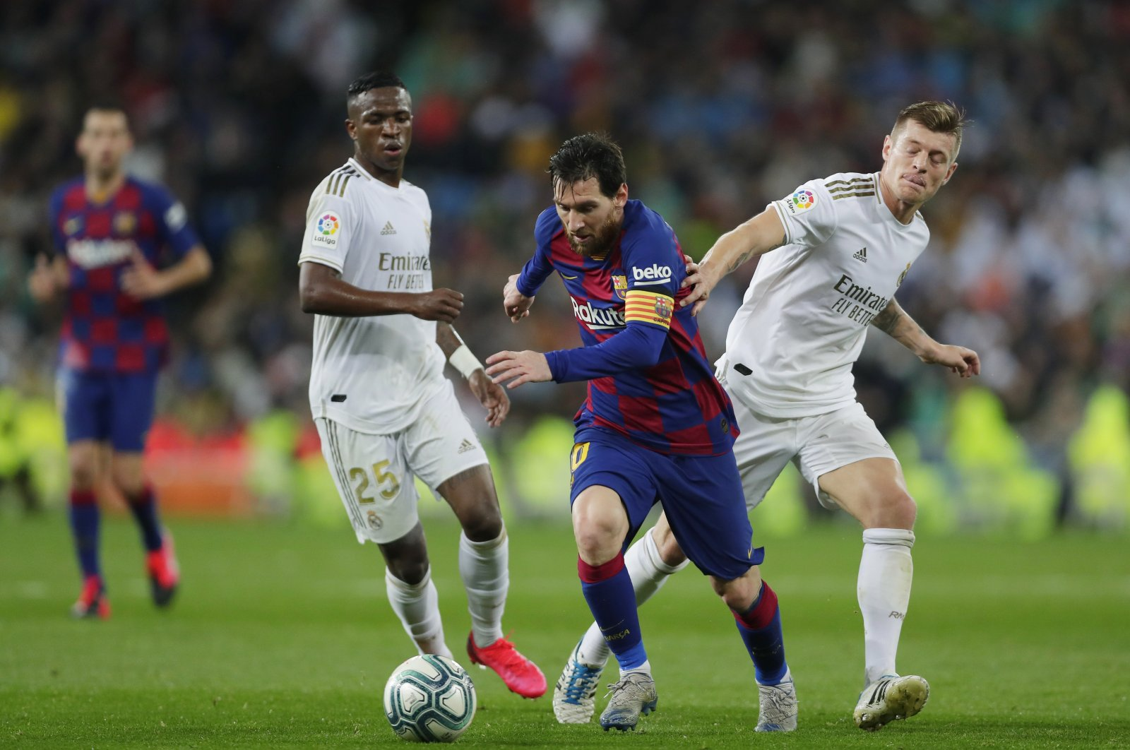Barcelona's Lionel Messi (C) competes for the ball with Real Madrid's Toni Kroos (R) and Vinicius Junior during a La Liga match in Barcelona, Spain, March 1, 2020. (AP Photo)