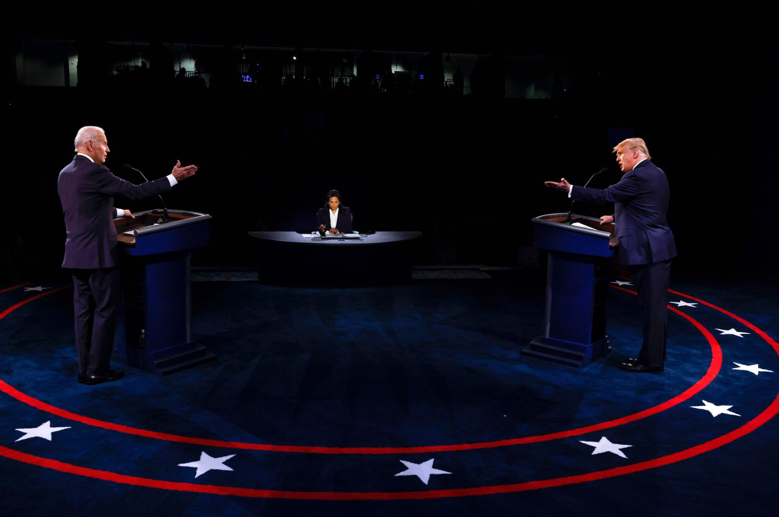 US President Donald Trump (R) Democratic Presidential candidate, former US Vice President Joe Biden and moderator, NBC News anchor, Kristen Welker (C) participate in the final presidential debate at Belmont University in Nashville, Tennessee, on October 22, 2020. (AFP Photo)