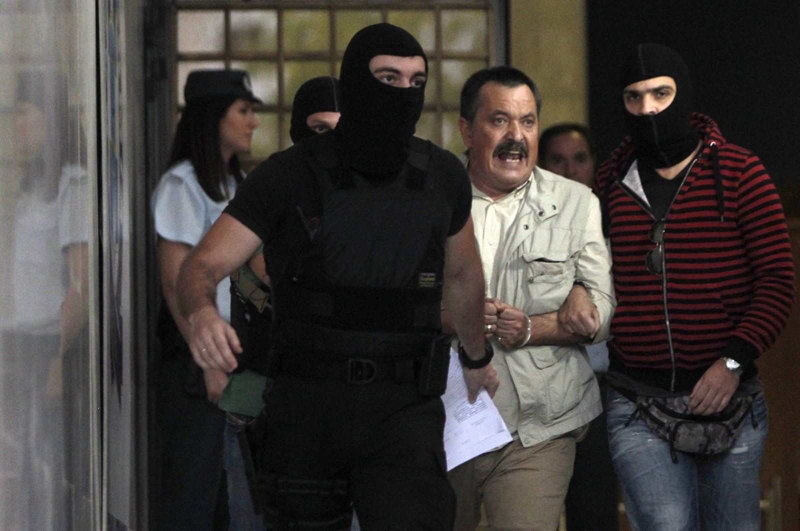 Lawmaker of extreme-right Golden Dawn party Christos Pappas (C) shouts as he leaves the Greek police headquarters in Athens on Sept. 29, 2013. (Reuters Photo)