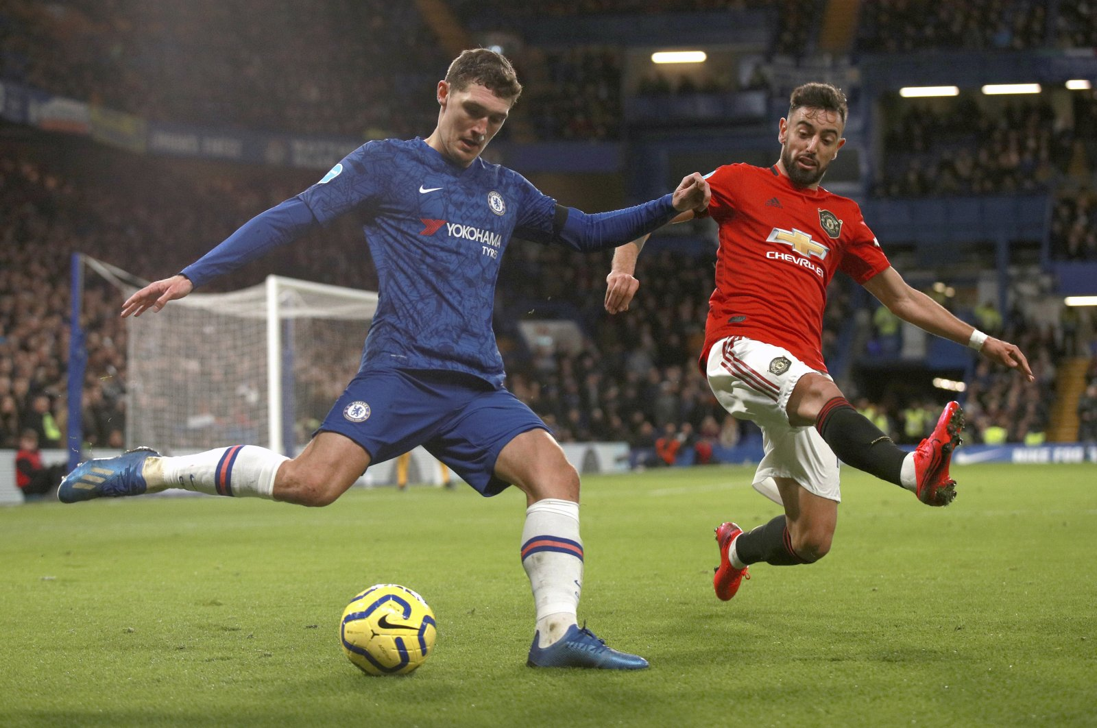 Chelsea's Andreas Christensen (L) and Manchester United's Bruno Fernandes in action during a match in London, England, Feb. 17, 2020. (AP Photo)