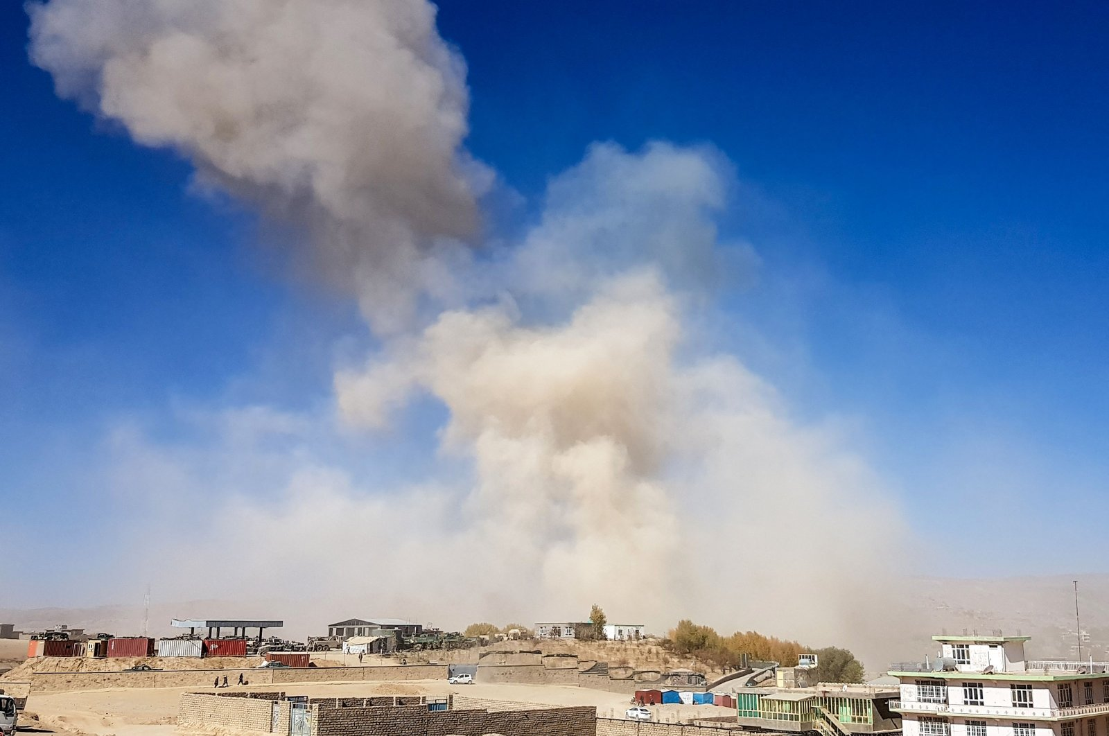 Smoke rises from the site of a car bomb attack that targeted Afghan police headquarters in Feroz Kho, the capital of Ghor Province on Oct. 18, 2020. (AFP Photo)