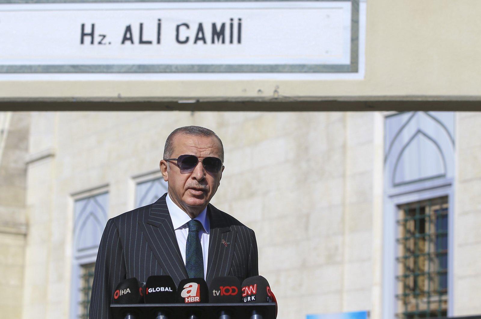 President Recep Tayyip Erdoğan responds to journalists' questions following Friday prayers in Istanbul, Turkey, Oct. 23, 2020. (AA)