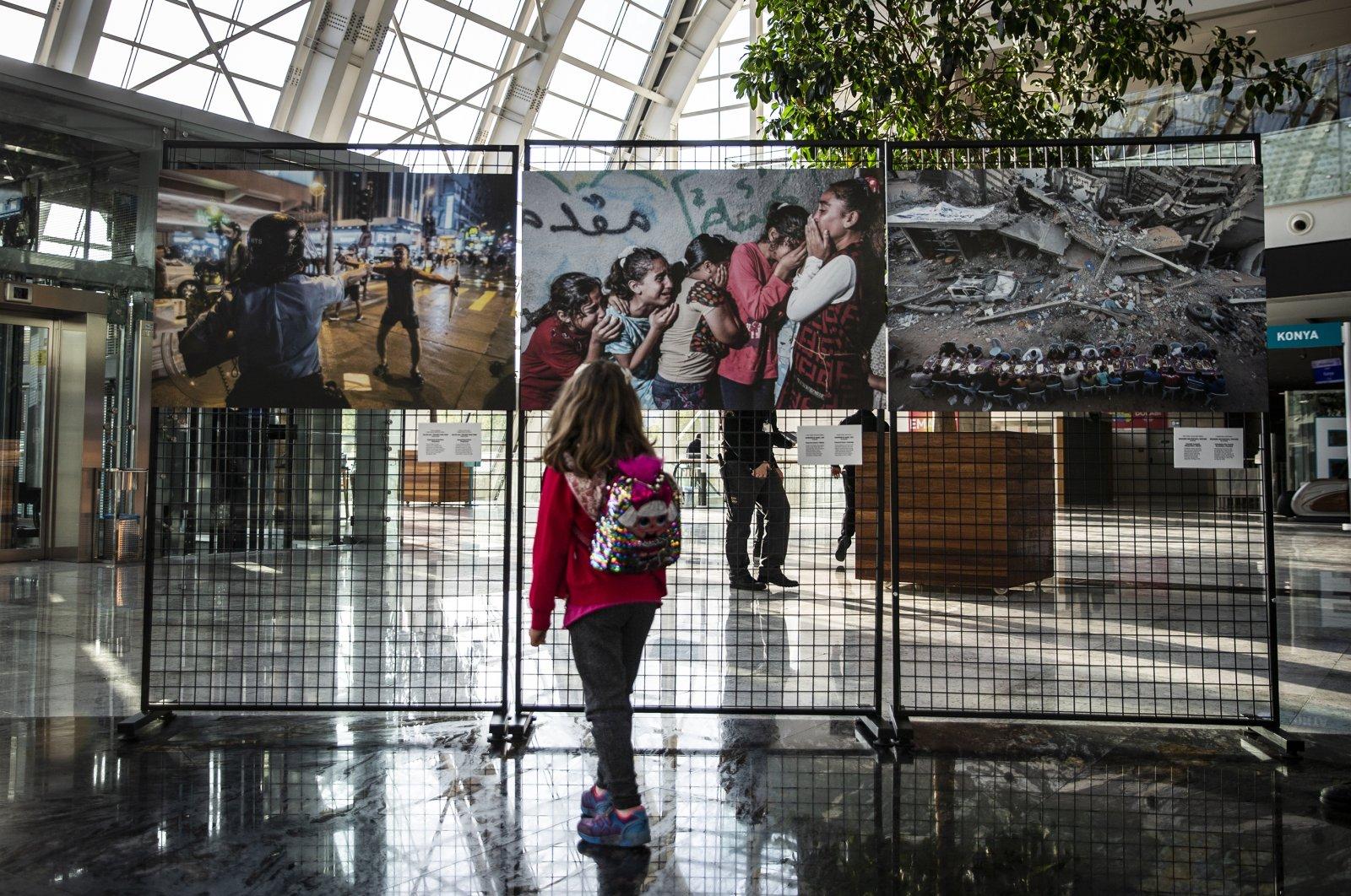 A visitor examines a photo at the exhibition, Ankara, Turkey, Oct. 22, 2020. (AA Photo)