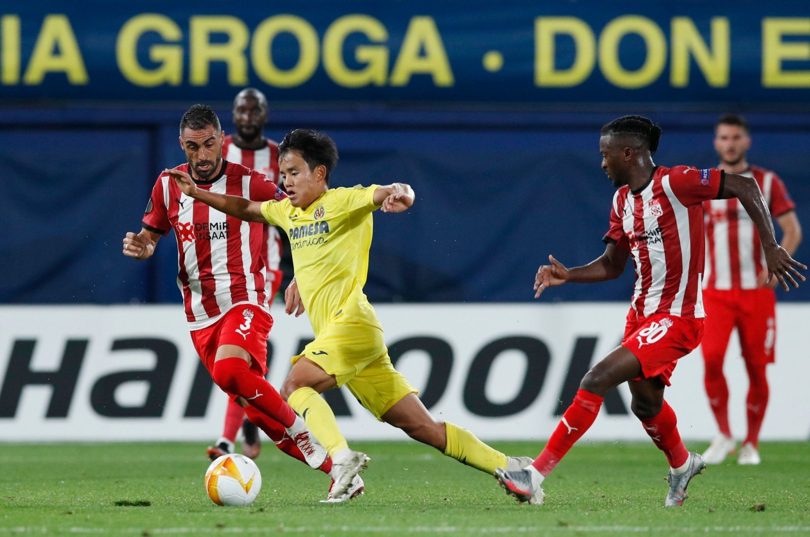 Villarreal's Takefusa Kubo (C) in action with Sivasspor's Uğur Çiftçi (L) and Olarenwaju Kayode during a UEFA Europa League match in Villareal, Spain, Oct. 22, 2020. (Reuters Photo)