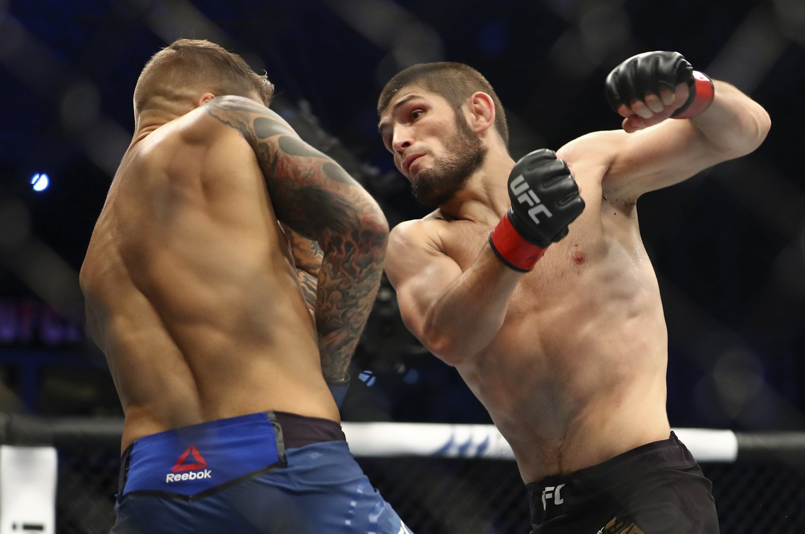 Khabib Nurmagomedov (R) fights Dustin Poirier at UFC 242, in Abu Dhabi, UAE, Sept. 7, 2019. (AP Photo)
