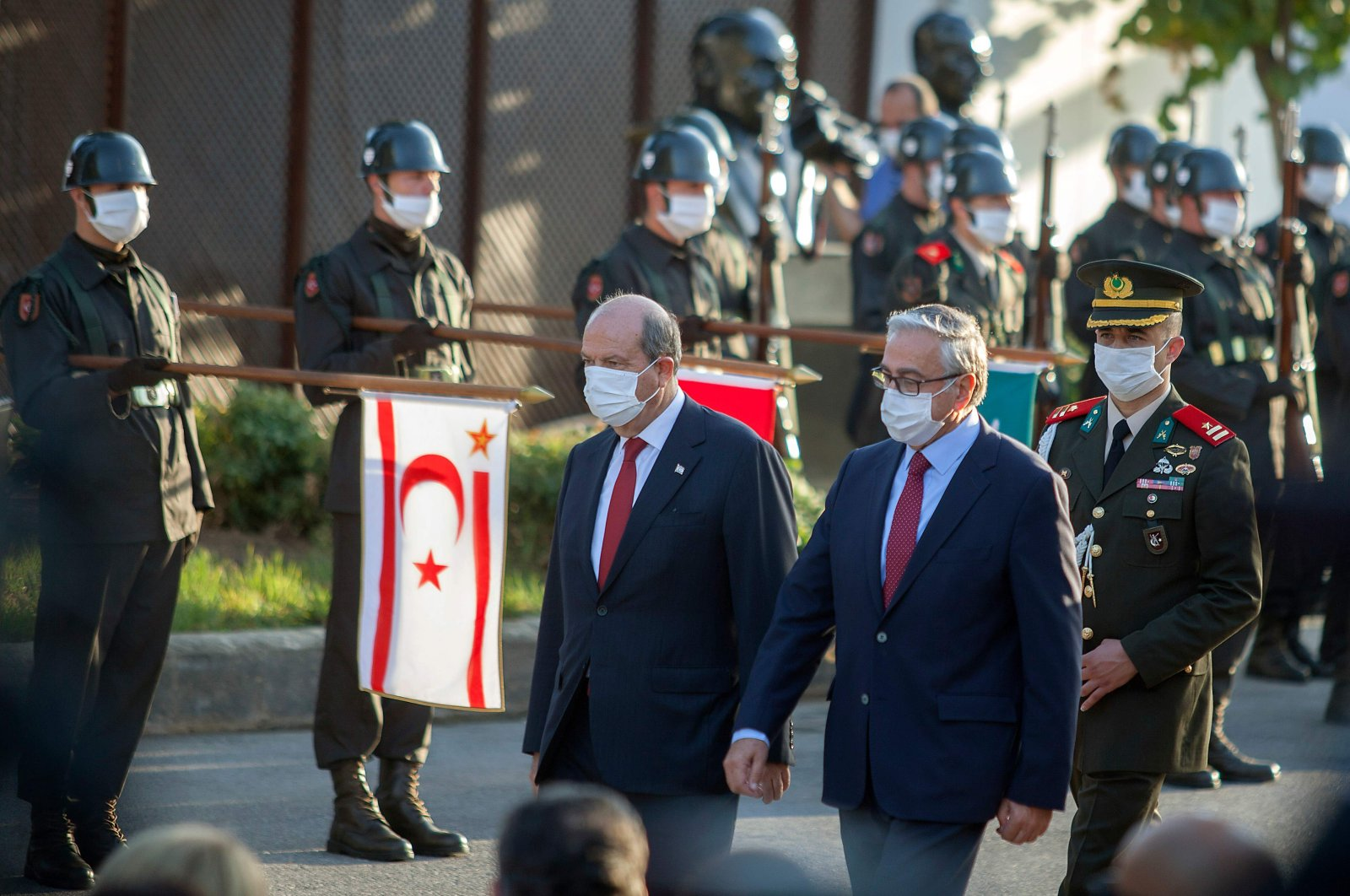Former Turkish-Cypriot leader Mustafa Akıncı (R) and newly elected President Ersin Tatar, arrive at a handover ceremony in the northern part of Nicosia, the capital of the Turkish Republic of Northern Cyprus (TRNC), Oct. 23, 2020. (AFP Photo)