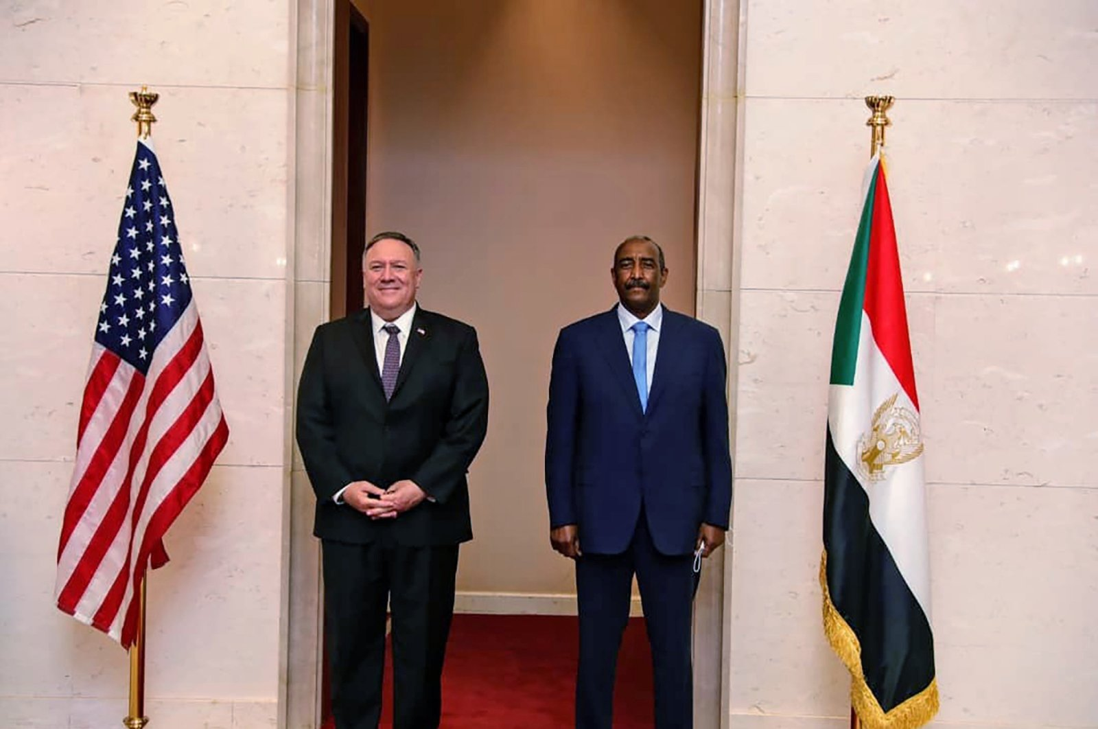 U.S. Secretary of State Mike Pompeo stands with Sudanese Gen. Abdel Fattah Burhan, the head of the ruling sovereign council, Khartoum, Aug. 25, 2020. (AP Photo)