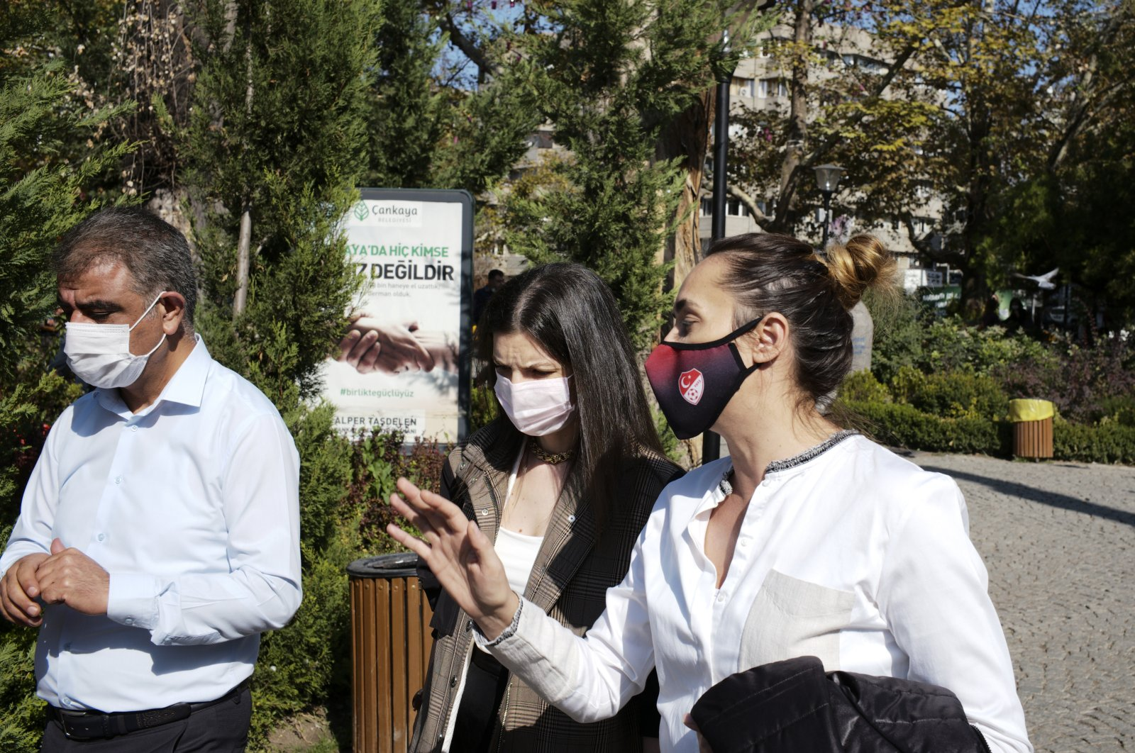 People wearing masks to help protect against the spread of coronavirus, walk in Ankara, Turkey, Friday, Oct. 23, 2020. (AP Photo)