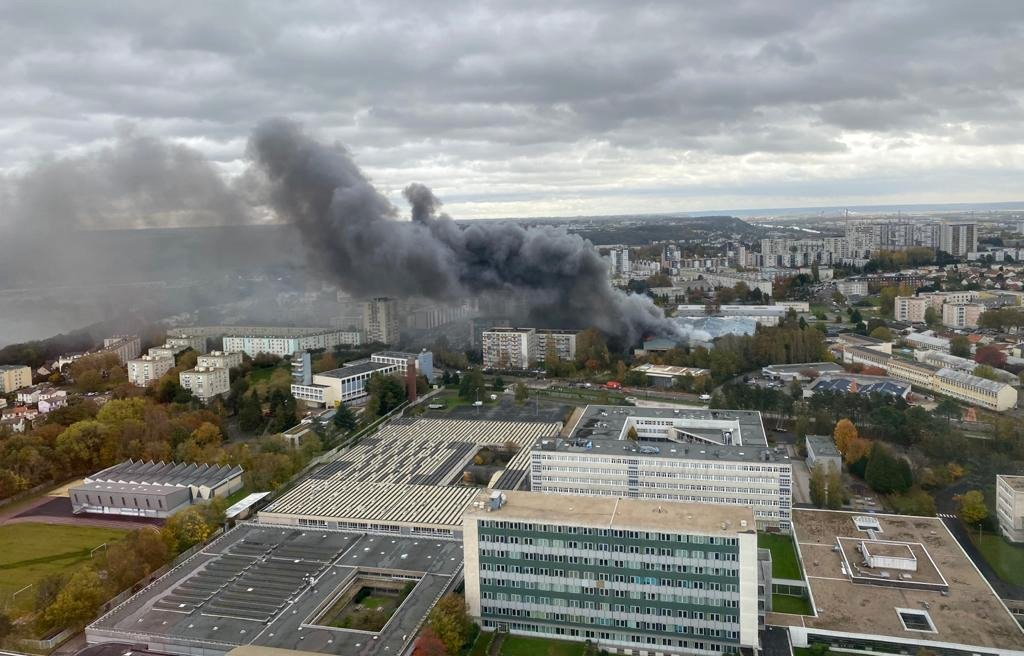 This grab taken from a video obtained by Civil Defence Agency of the French Government (Securite Civile) shows a fire broke out from a Lipton tea manufacturer warehouse in Le Havre on October 24, 2020. (Securite Civile / AFP Photo)