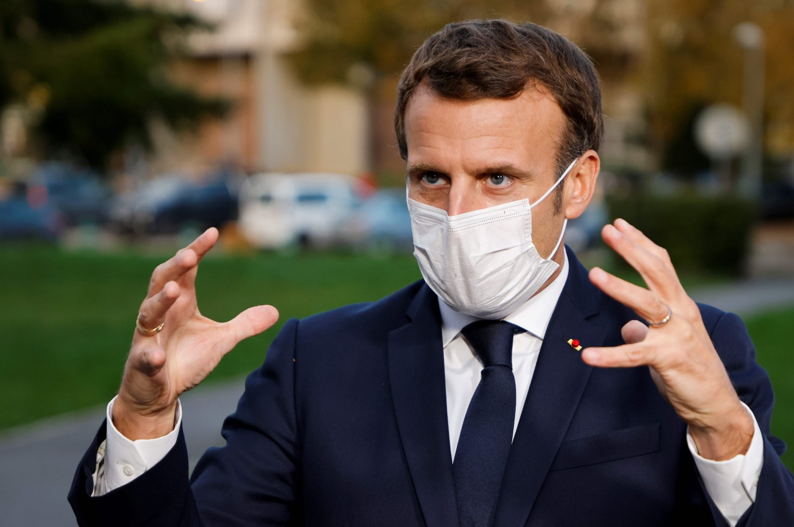 French President Emmanuel Macron speaks to the press after chairing a meeting with the medical staff of the Rene Dubos hospital center in Pontoise, in the Val d'Oise, France, Oct. 23, 2020. (AFP Photo)