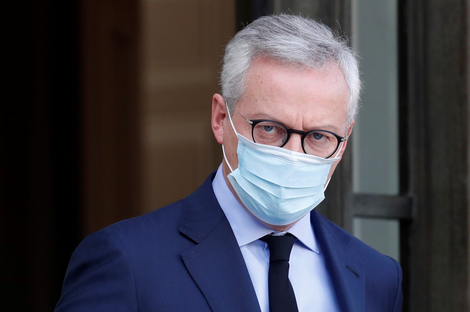 Bruno Le Maire, the French Minister of the Economy, Finance, and Recovery, wearing a protective mask, leaves following the weekly cabinet meeting at the Elysee Palace in Paris, Oct. 21, 2020. (Reuters Photo)