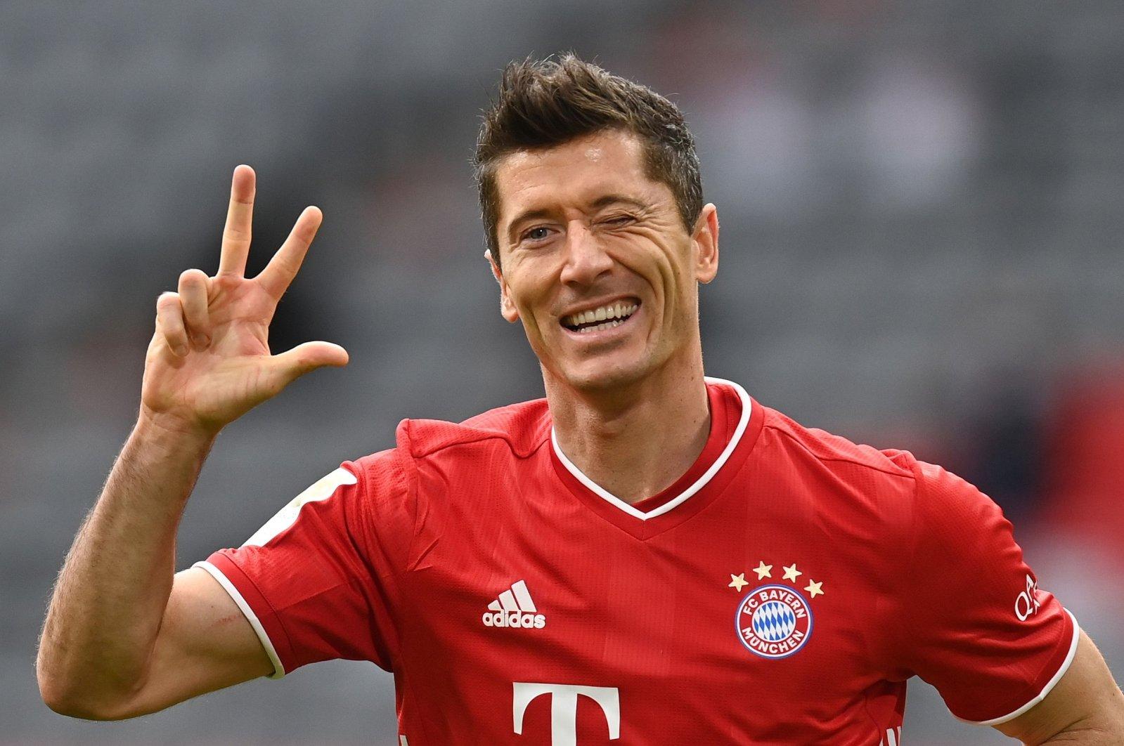 Bayern Munich's Polish forward Robert Lewandowski celebrates scoring his third for his hat-trick during the German first division Bundesliga football match against Eintracht Frankfurt on Oct. 24, 2020, in Munich, southern Germany. (AFP Photo)