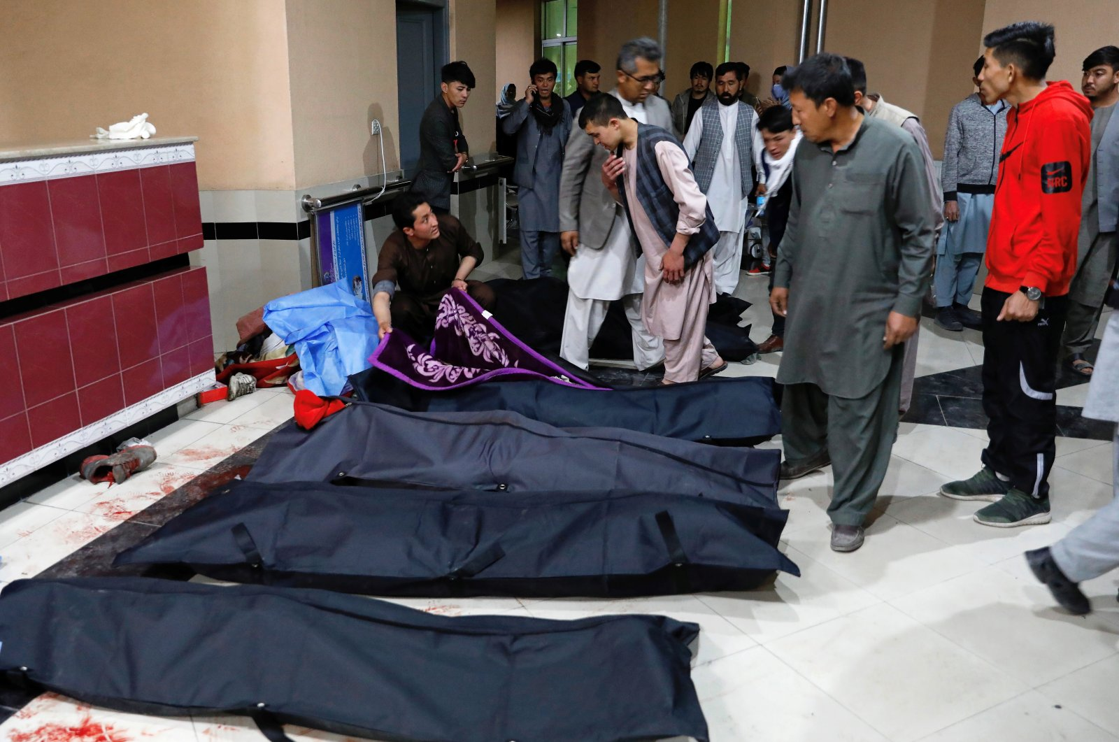 Afghan men look for their relatives at a hospital after a suicide bombing in Kabul, Afghanistan Oct. 24, 2020. (Reuters Photo)