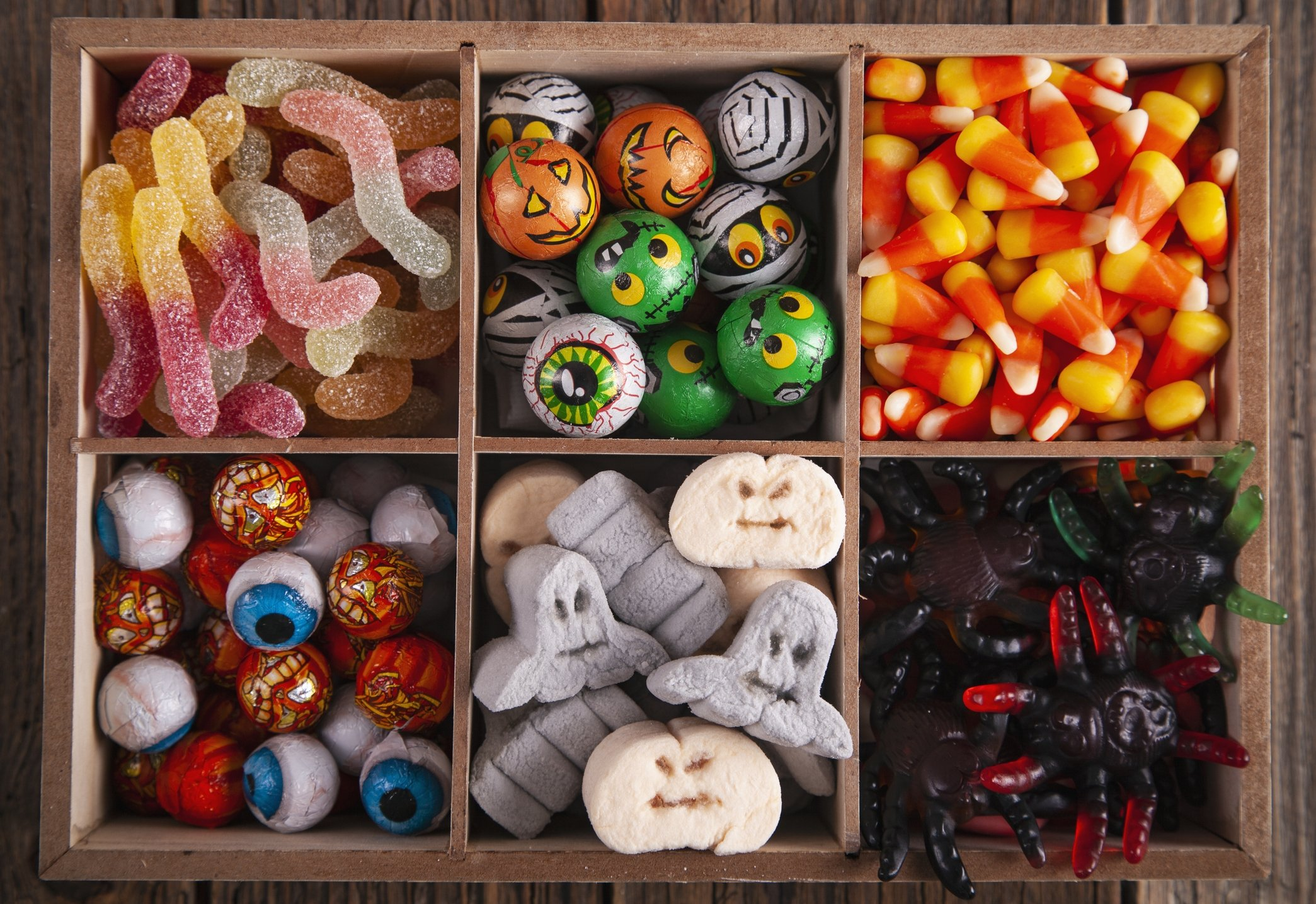 Use a variety of spooky sweets to decorate your Halloween-themed snacks. (iStock Photo)