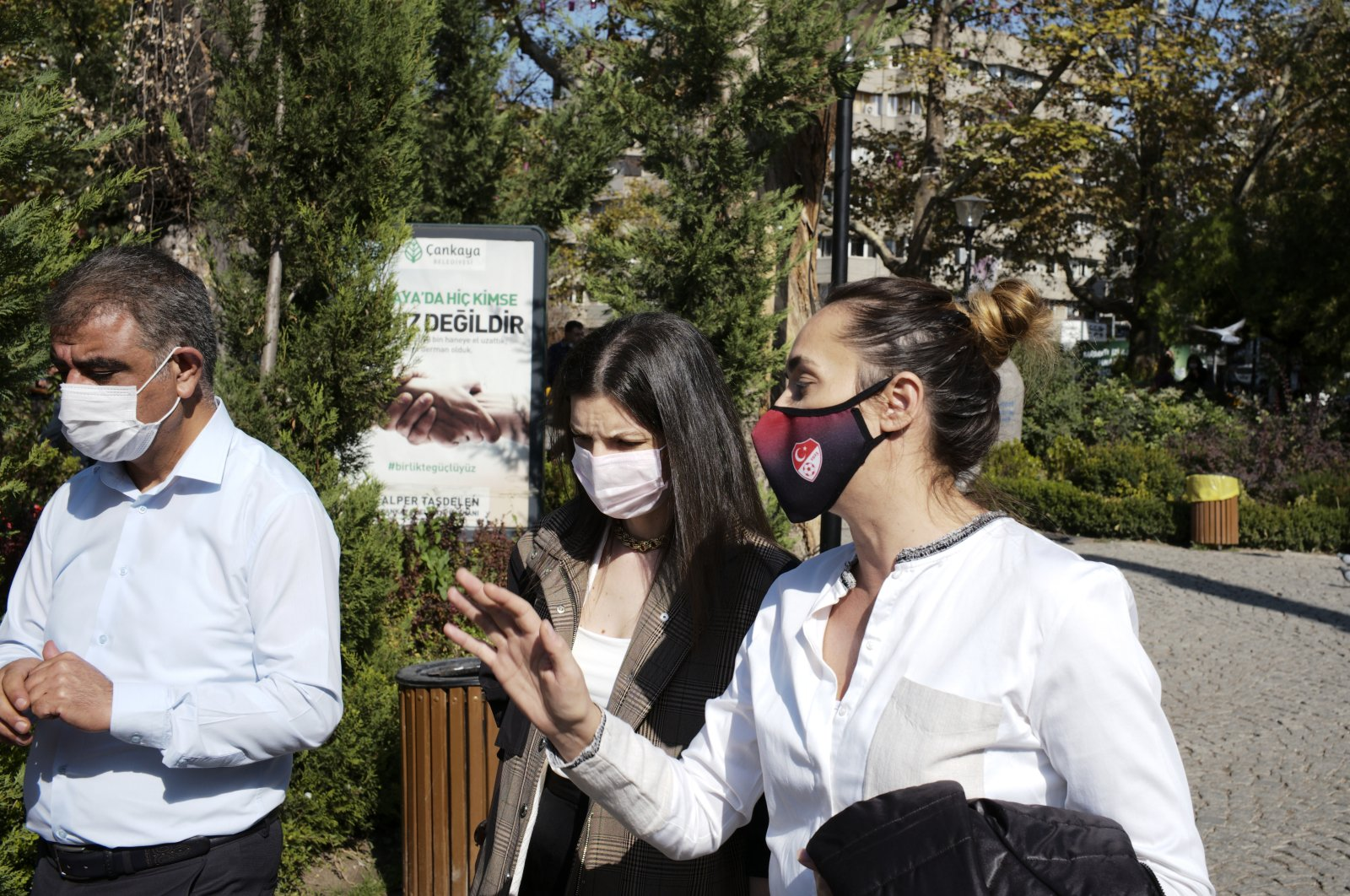 People wearing protective masks walk on a street in the capital Ankara, Turkey, Oct. 23, 2020. (AP Photo)