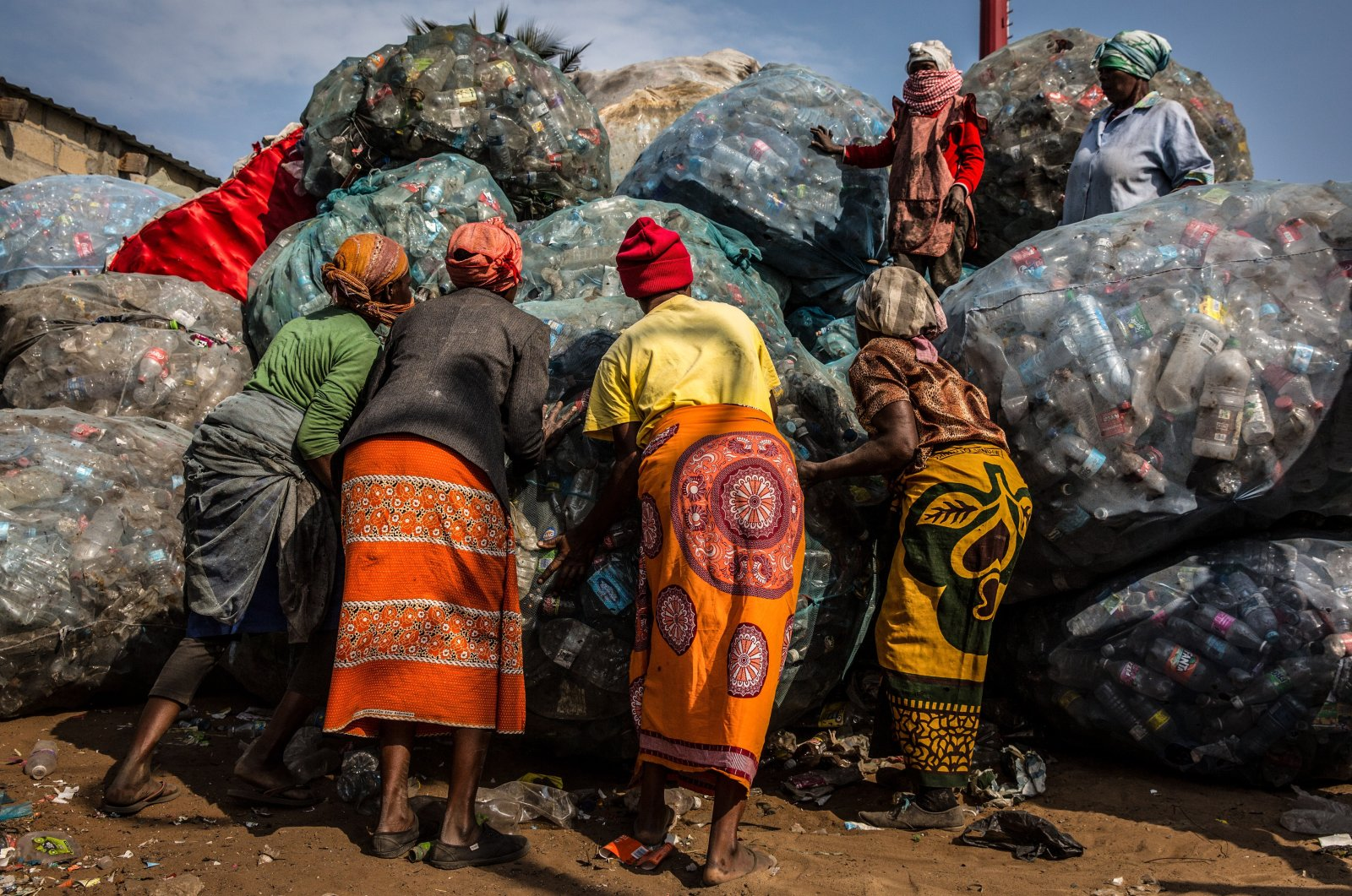 Plastic waste pickers at Hulen dump in Maputo, where they will weigh and sell the effort of their work to a company that will do the recycling, Mozambique, Aug. 20, 2020. (EPA Photo)