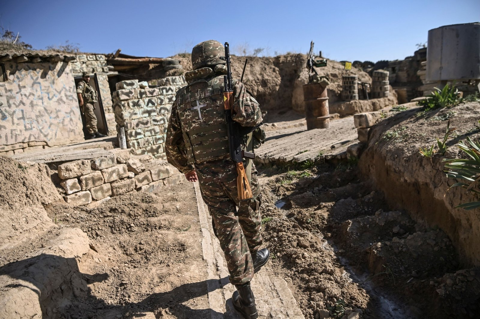 An Armenian soldier walks as troops hold positions on the front line in the occupied region of Nagorno-Karabakh on Oct. 25, 2020. (AFP Photo)