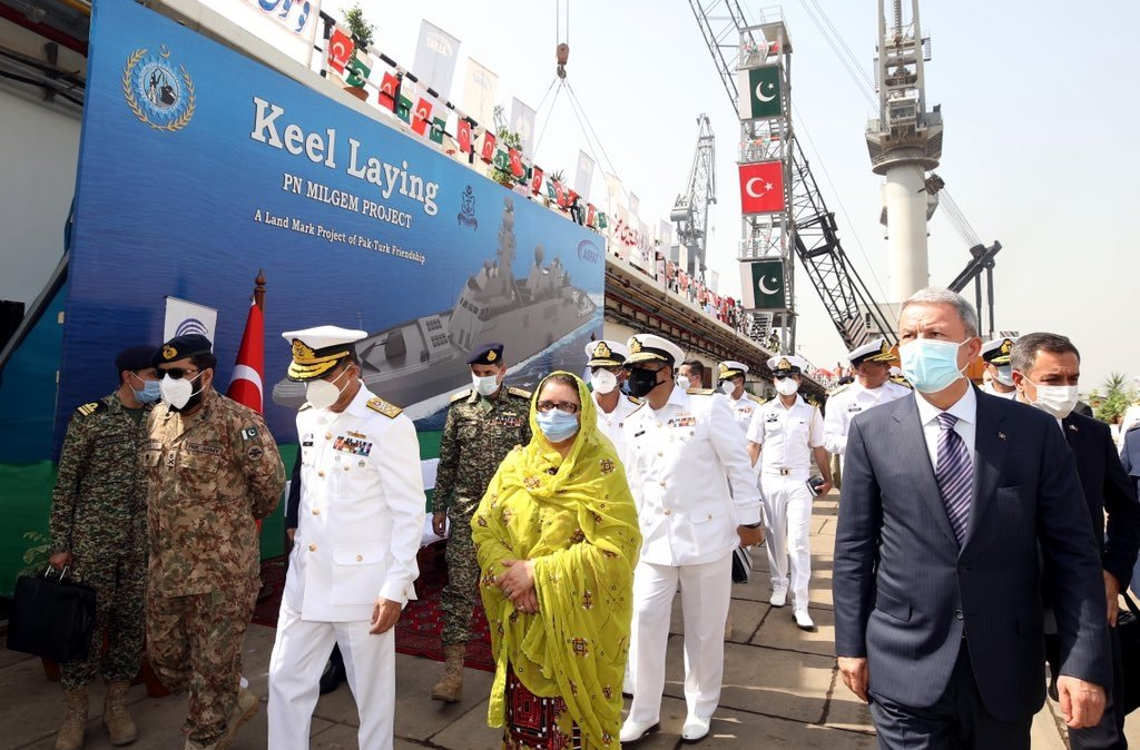 Turkish Defense Ministry Hulusi Akar (R), Pakistani Defense Production Minister Zubaida Jalal Khan (C), along with officials from both countries attend the keel-laying ceremony for the Pakistan Navy's 3rd MILGEM-class corvette, Karachi, Pakistan, Oct. 25, 2020. (DHA Photo)