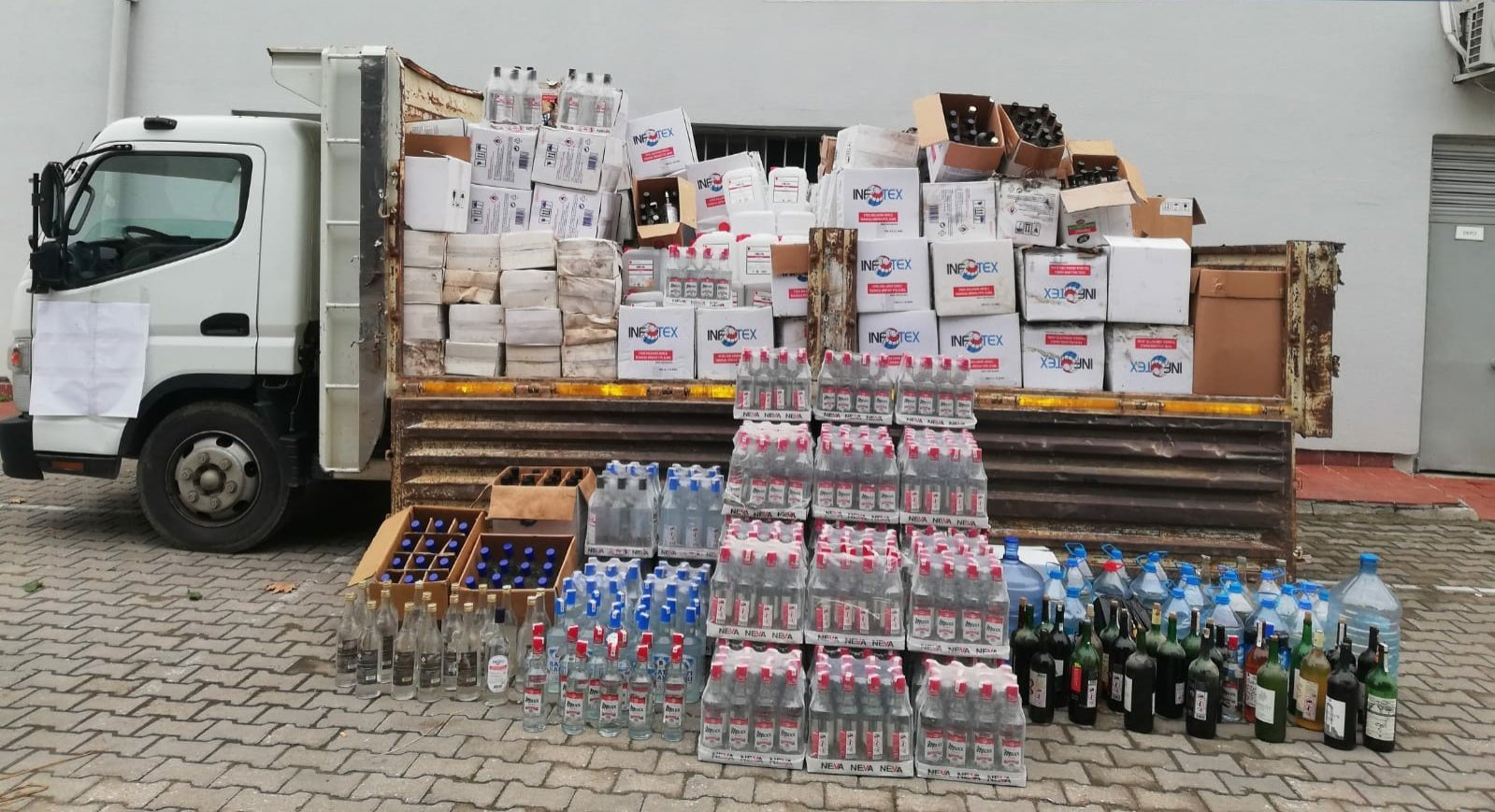 Bootleg alcohol seized in an operation on display, in Çanakkale, western Turkey, Oct. 23, 2020. (İHA Photo)