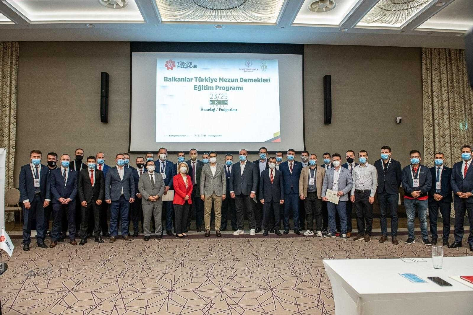 YTB President Abdullah Eren (C) poses with participants, in Podgorica, Montenegro, Oct. 26, 2020. (COURTESY OF YTB)