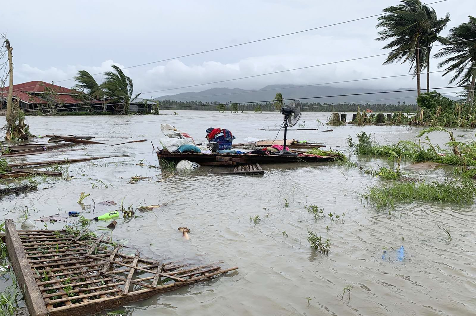 The remains of a house is surrounded by floods in Pola town on the island of Mindoro, central Philippines, Monday, Oct. 26, 2020.  (AP Photo)
