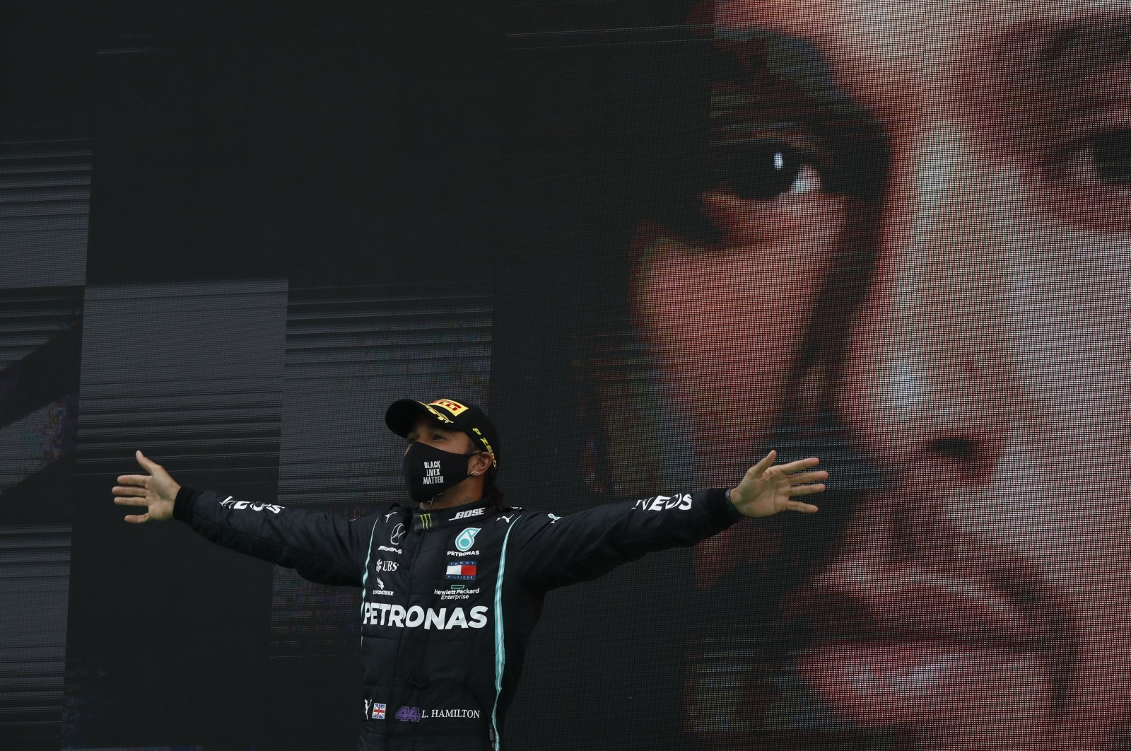 Mercedes driver Lewis Hamilton celebrates after winning the Formula One Portuguese Grand Prix in Portimao, Portugal, Oct. 25, 2020. (AP Photo)